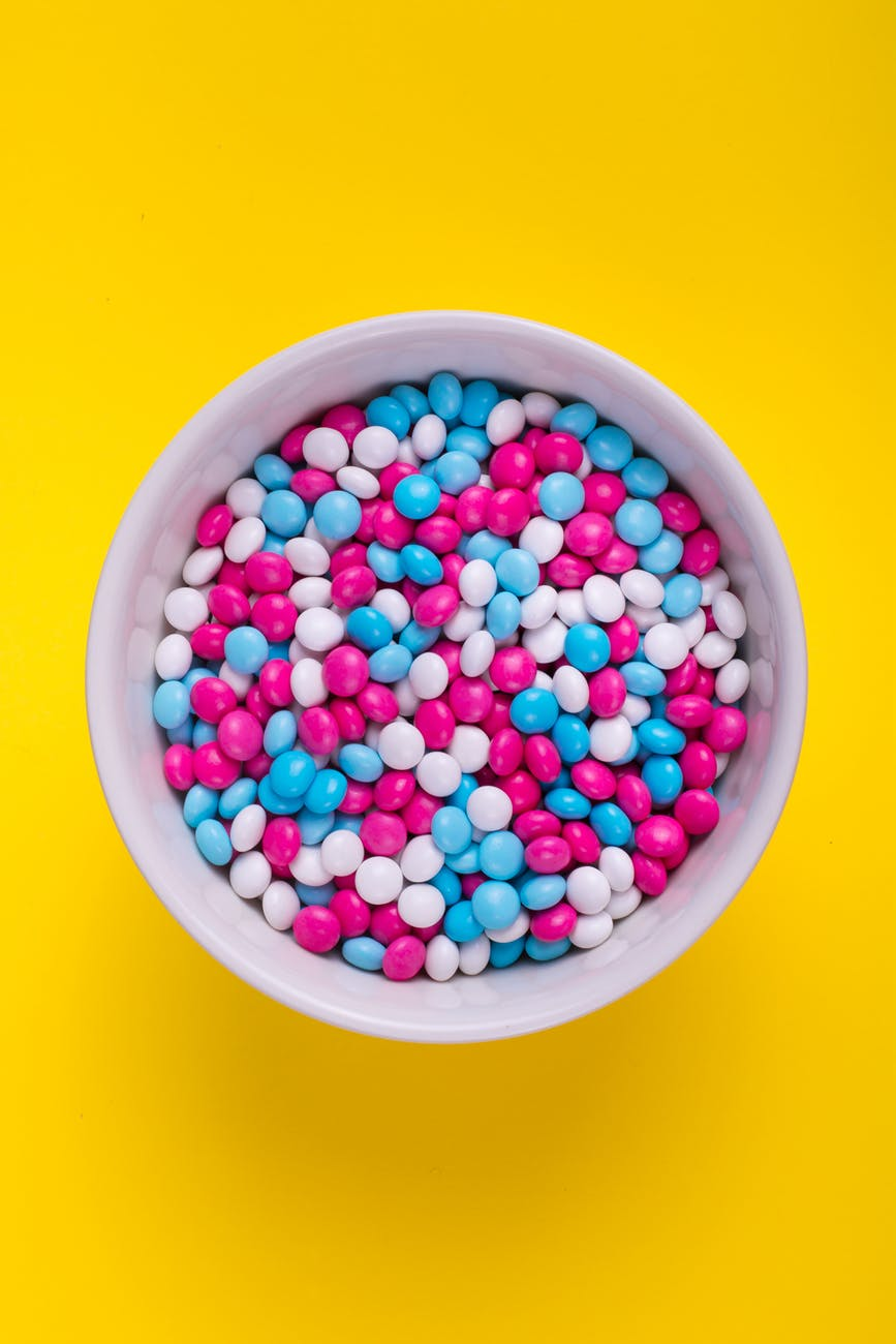m&m chocolates in a white bowl
