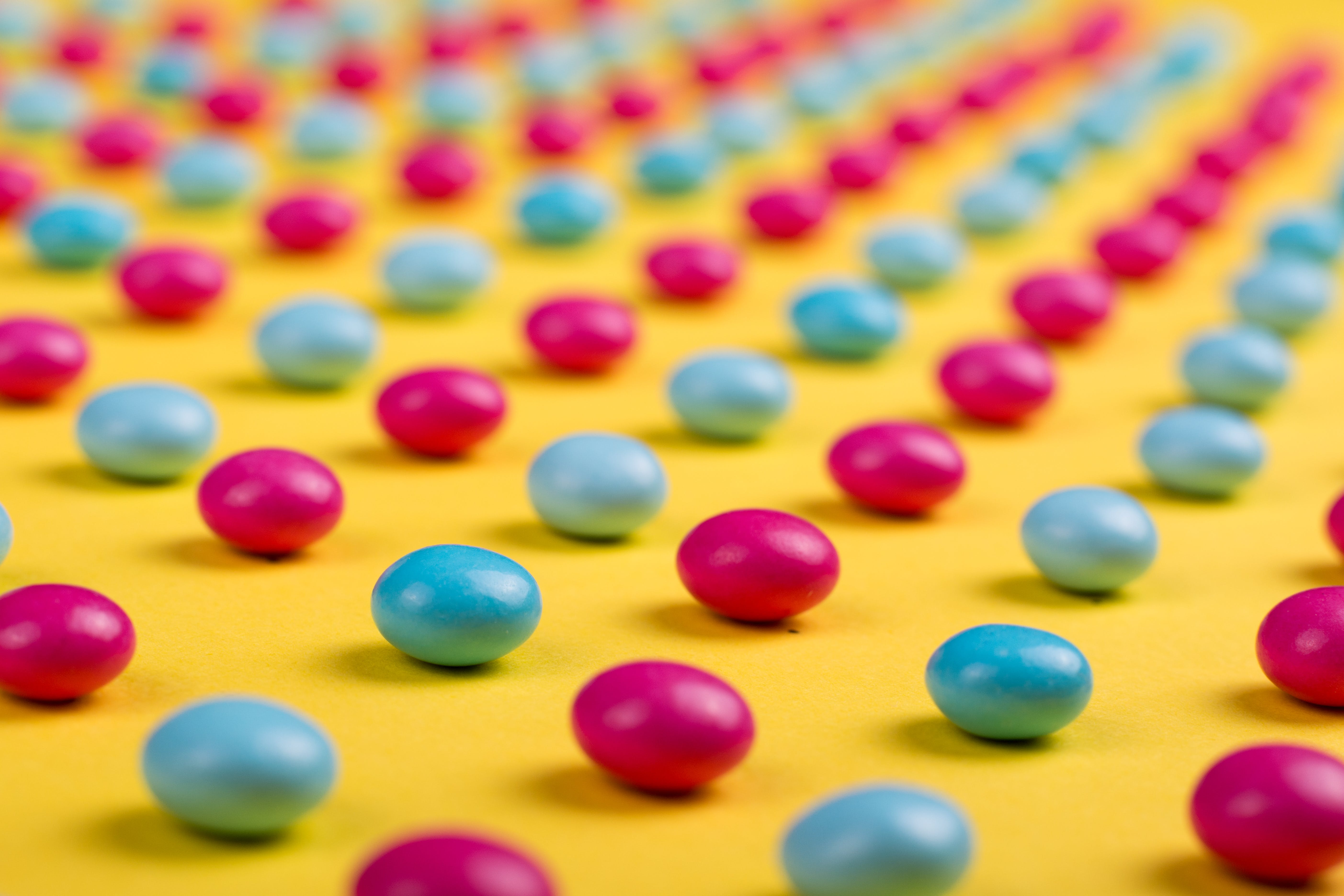 Selective Focus Photo of Round Pink-and-blue Beads