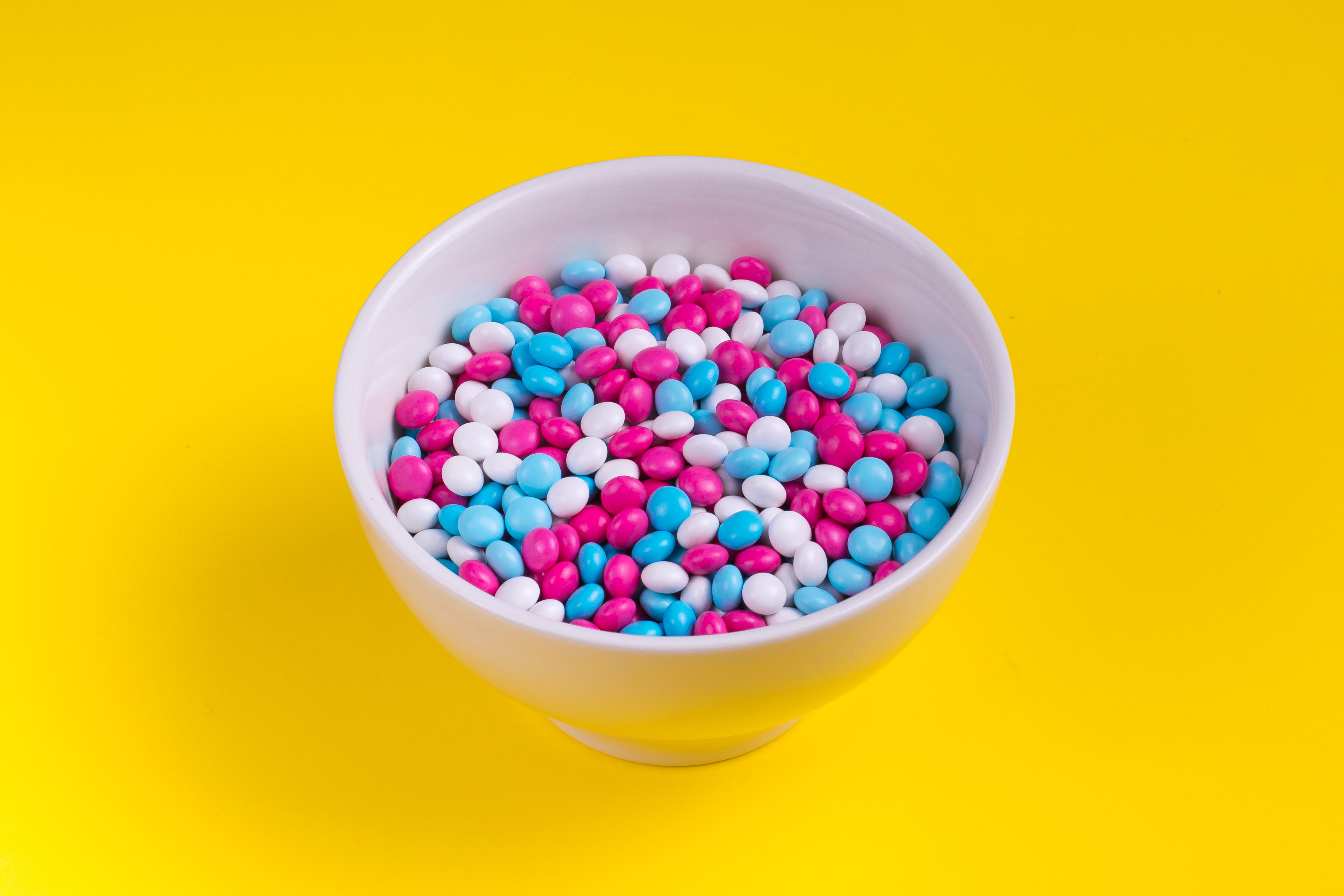 White, Pink, and Blue Candies in Bowl