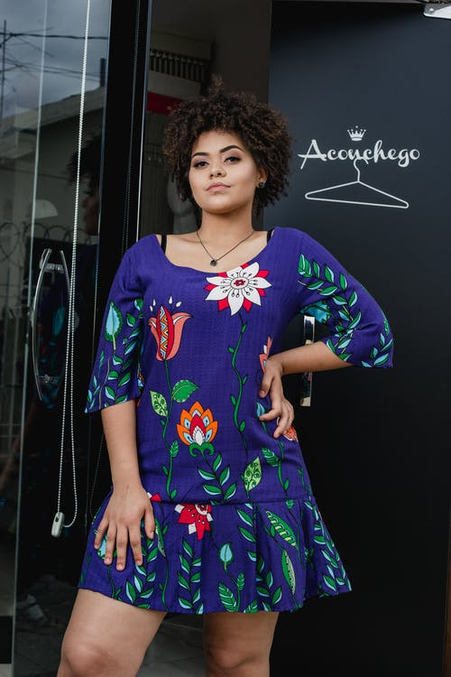 Person Wearing Purple and Green Floral Dress