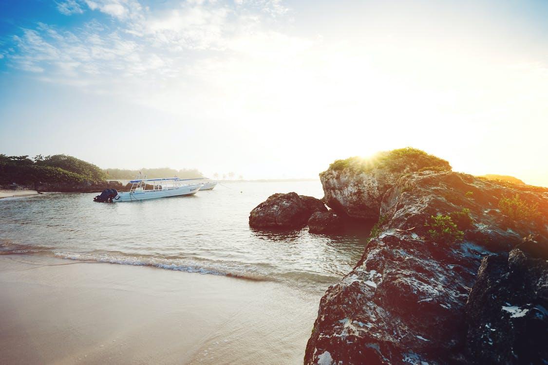 Motorboat on Seashore Near Rocks