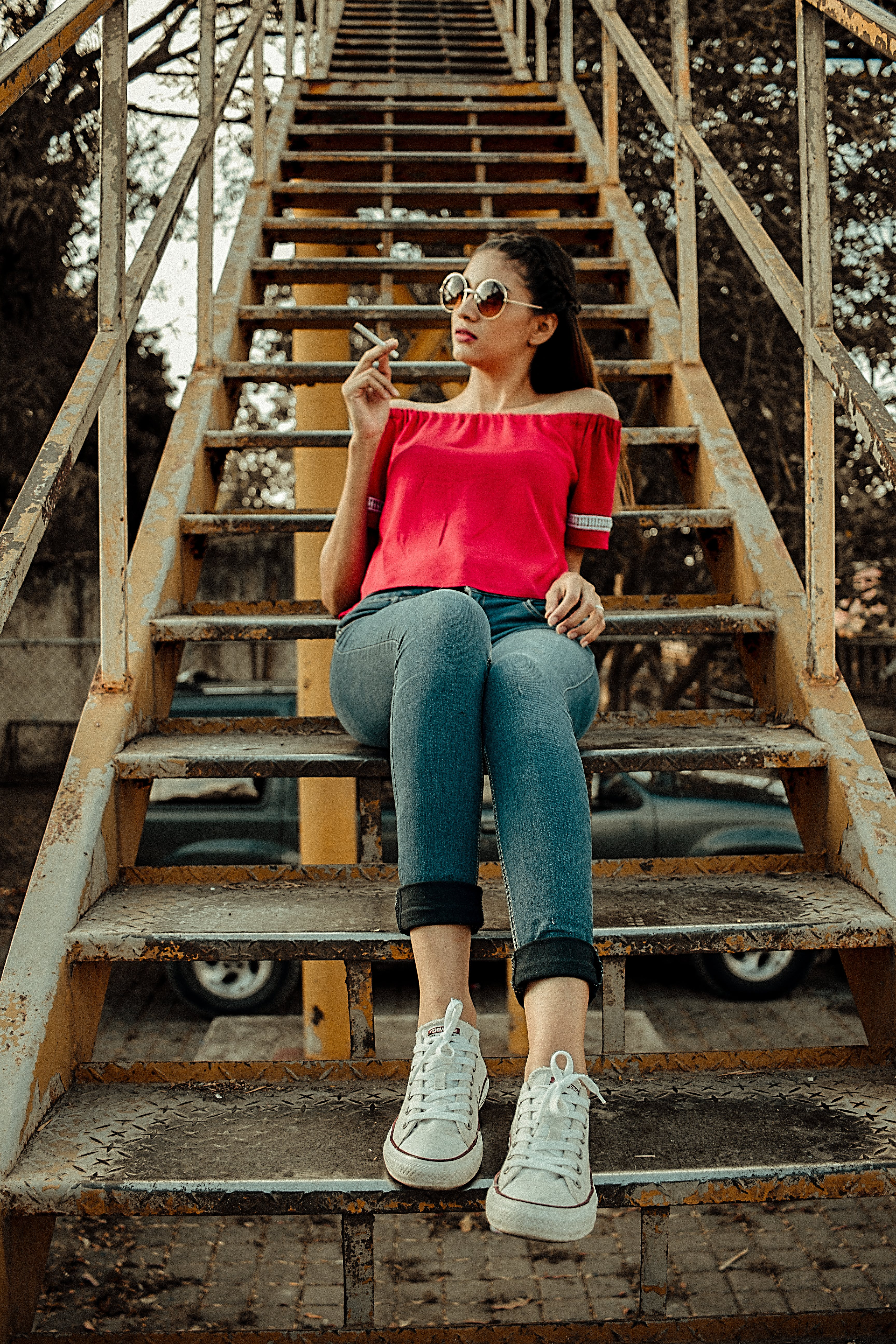 Woman Sitting on Yellow and Black Stairway