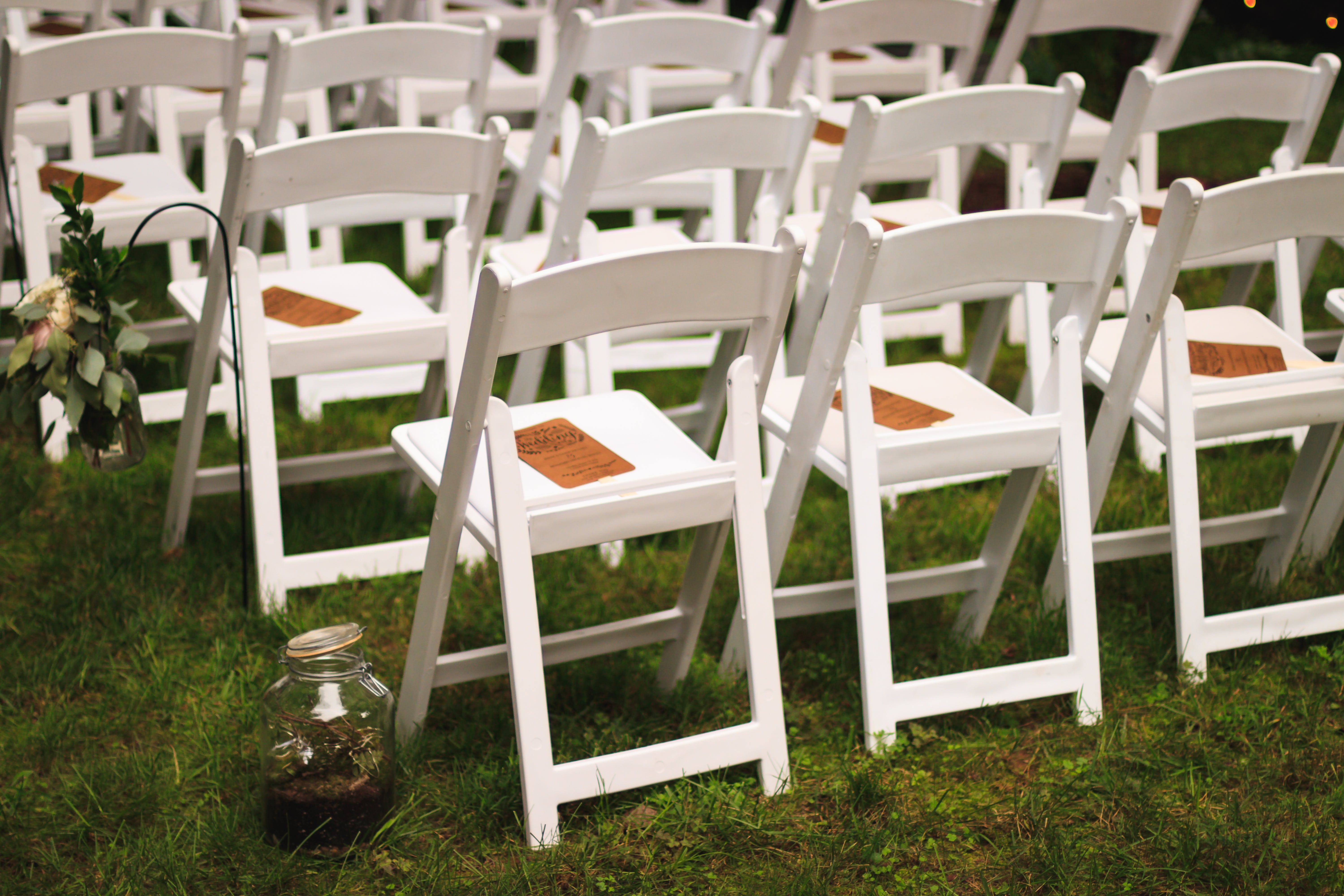 White Wooden Chairs on Green Grass Field