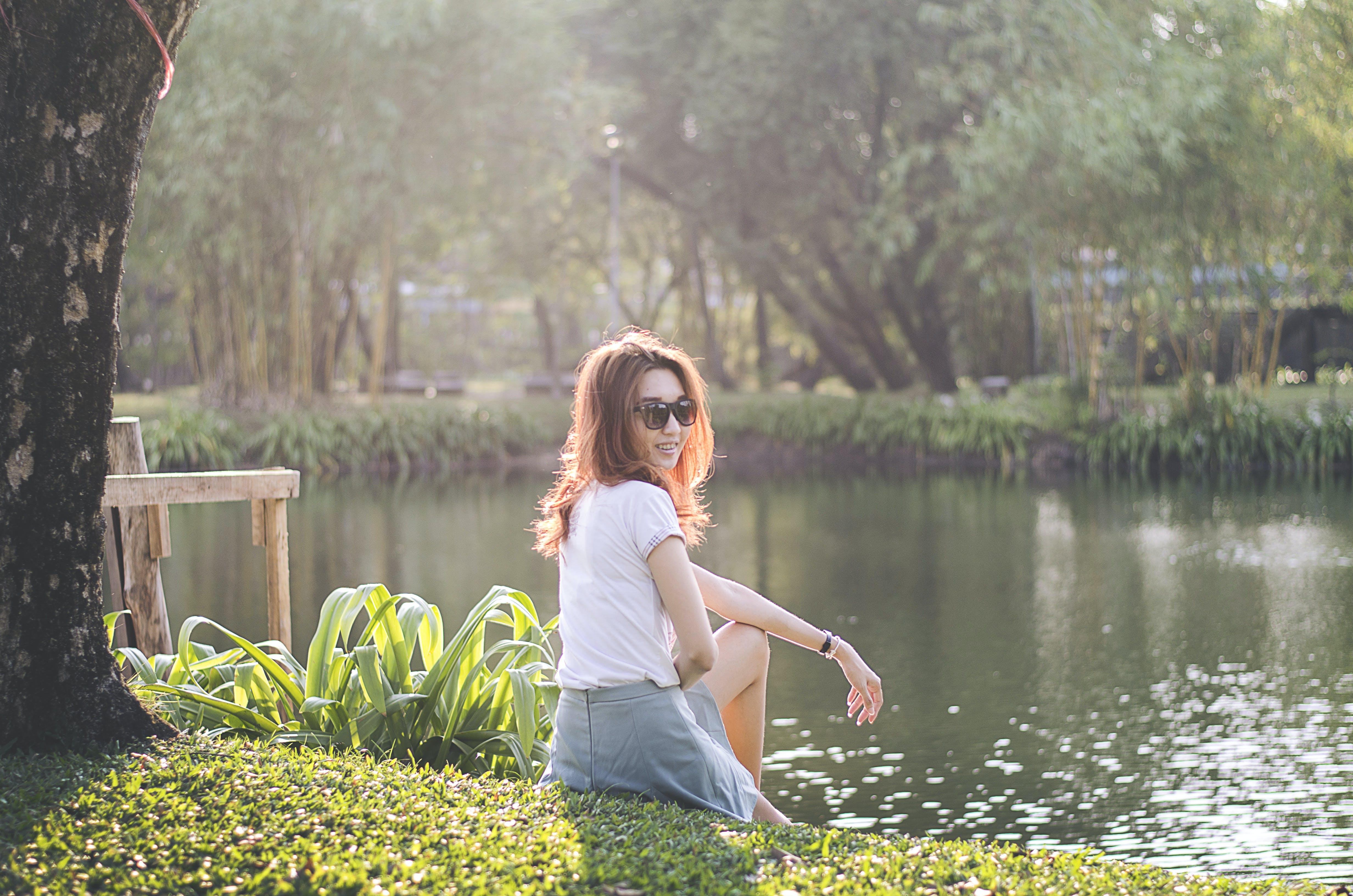 Woman in White T-shirt Near Swamp Lake