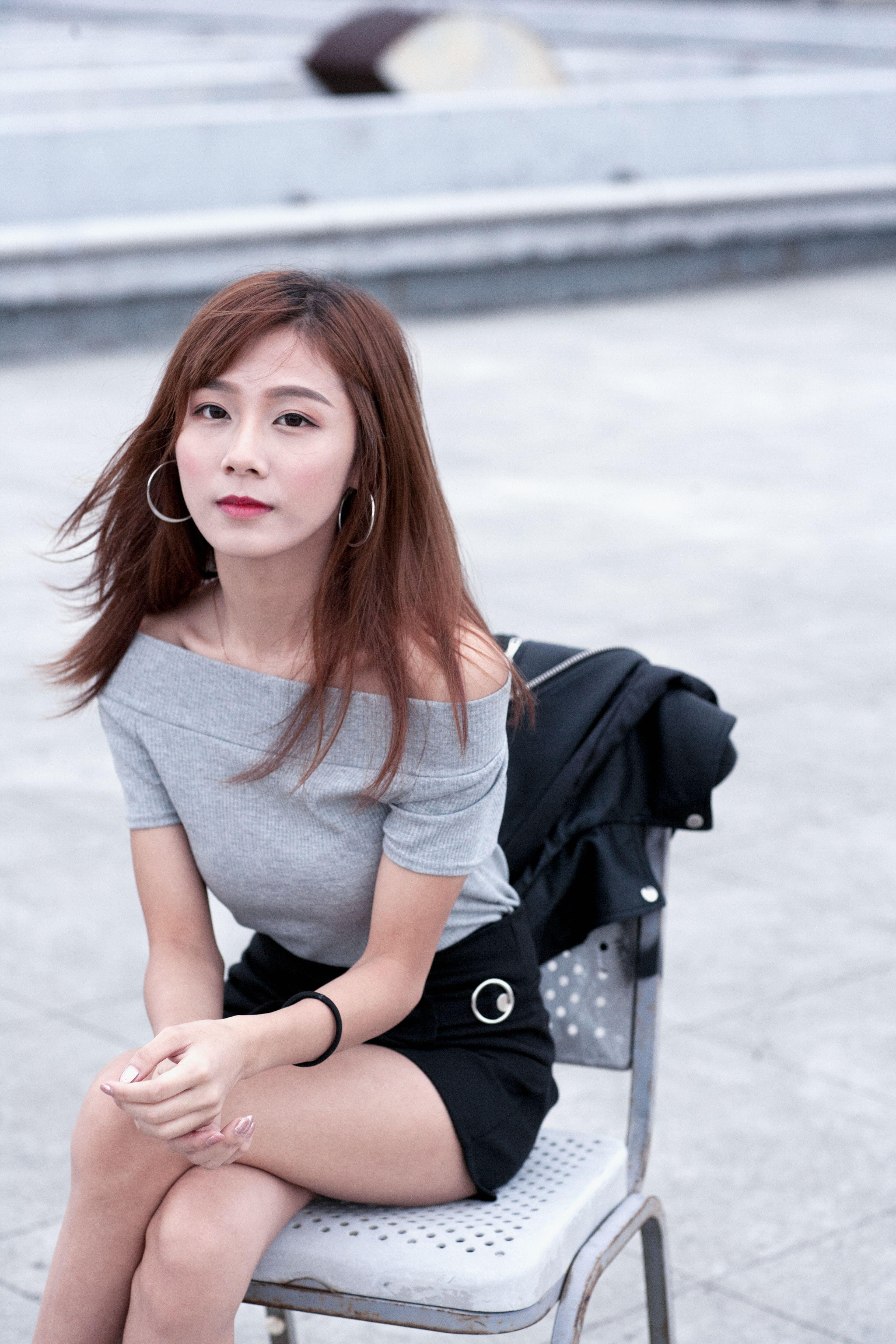 Woman Sitting on Gray Metal Bench
