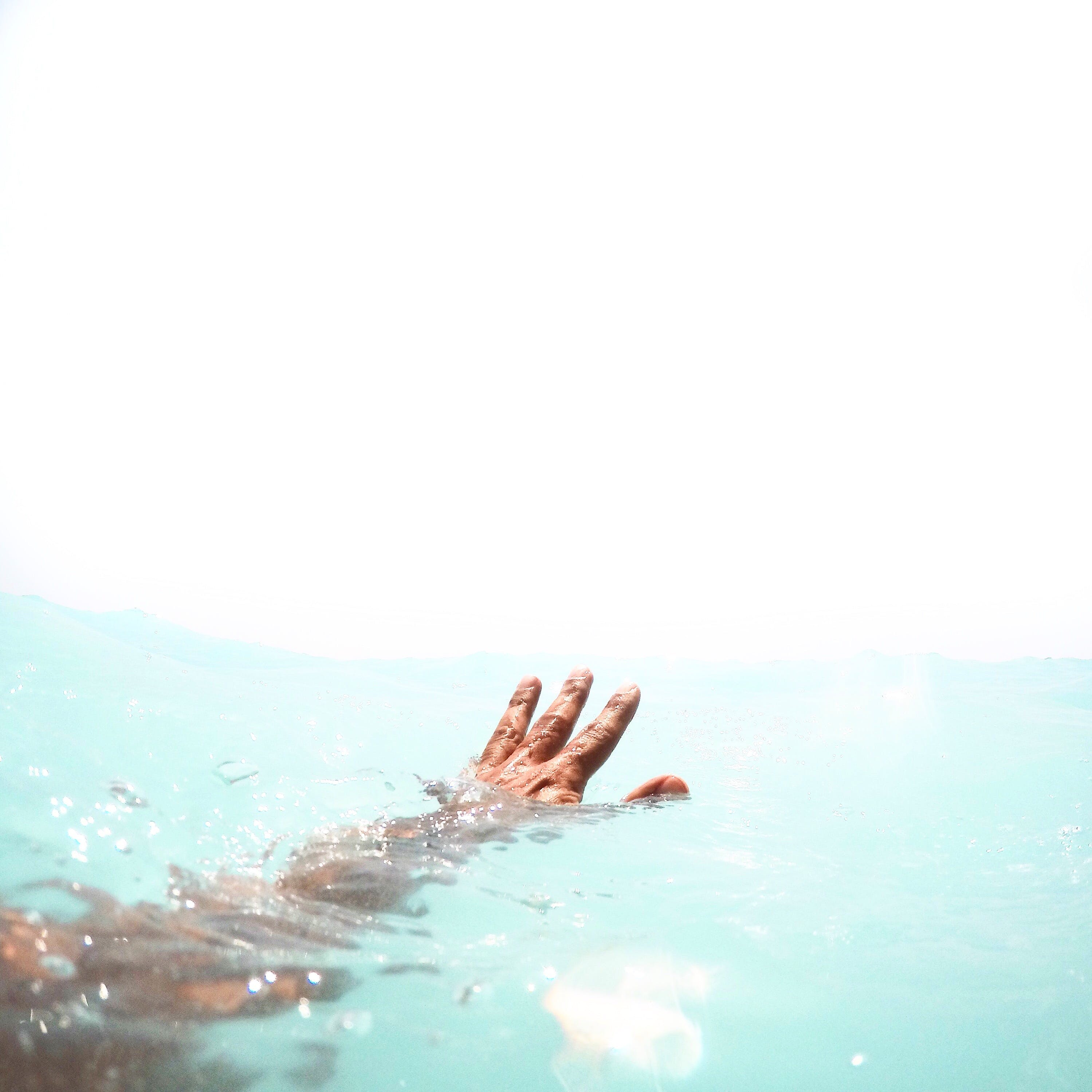 Person Reaching Out on Water