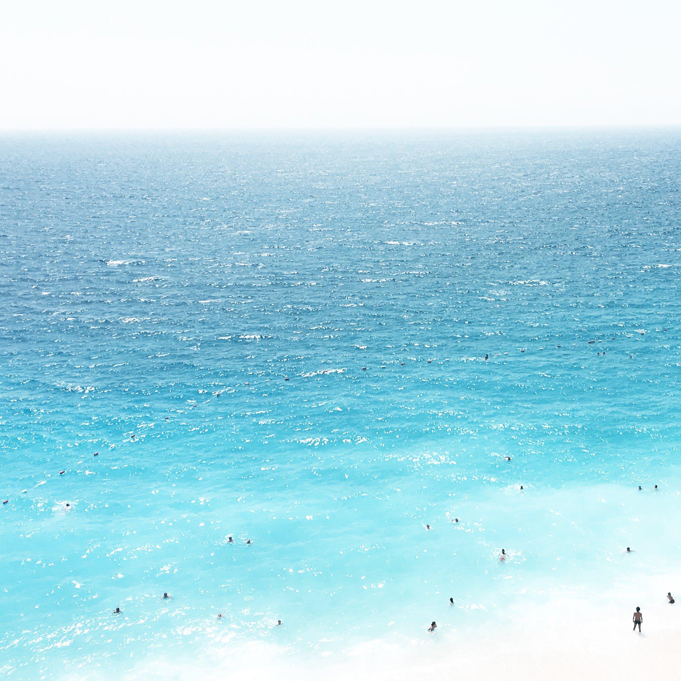 Бесплатное стоковое фото с бирюзовый, вода, волны, лето