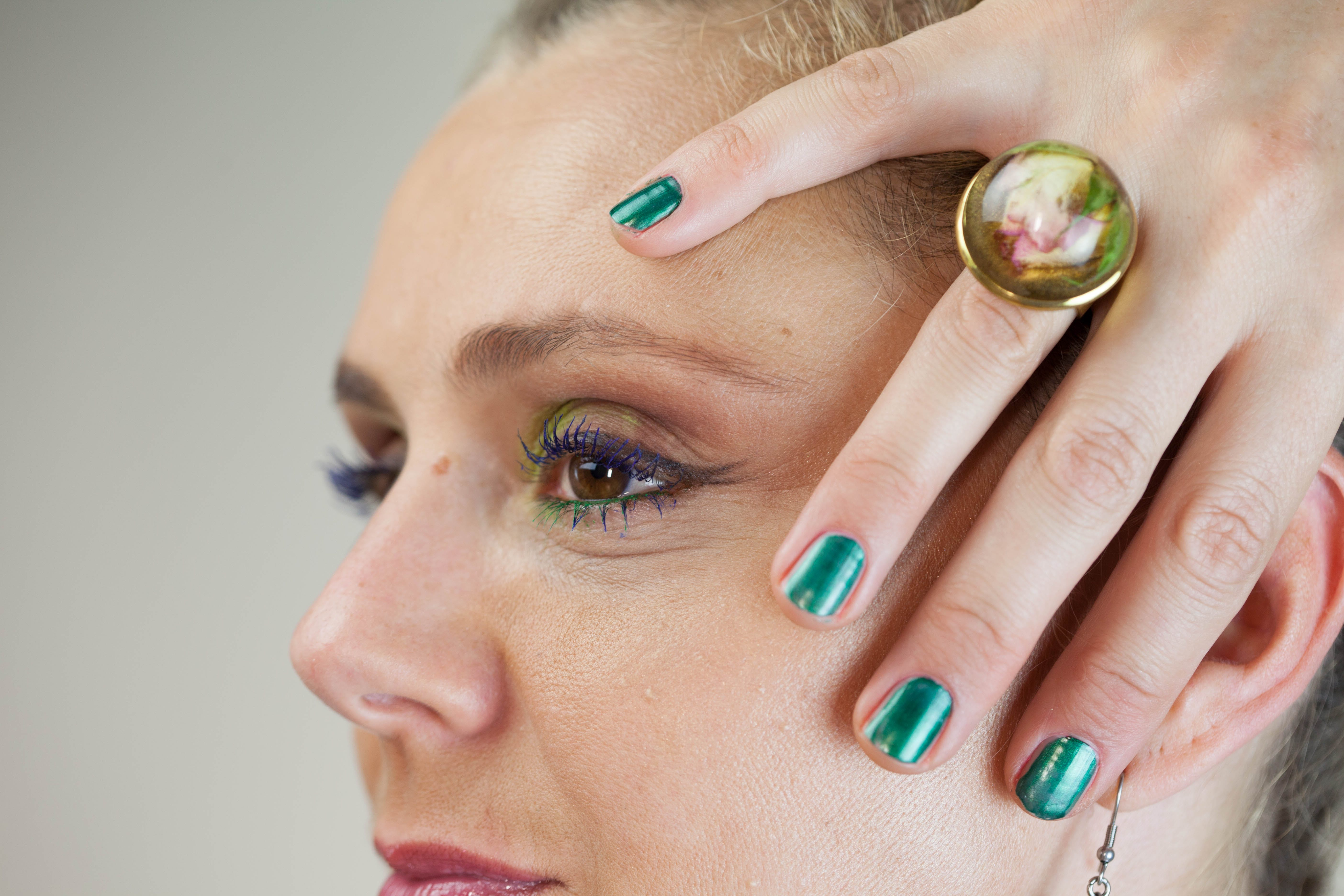 Person Wearing Gold-colored Ring Holding Face