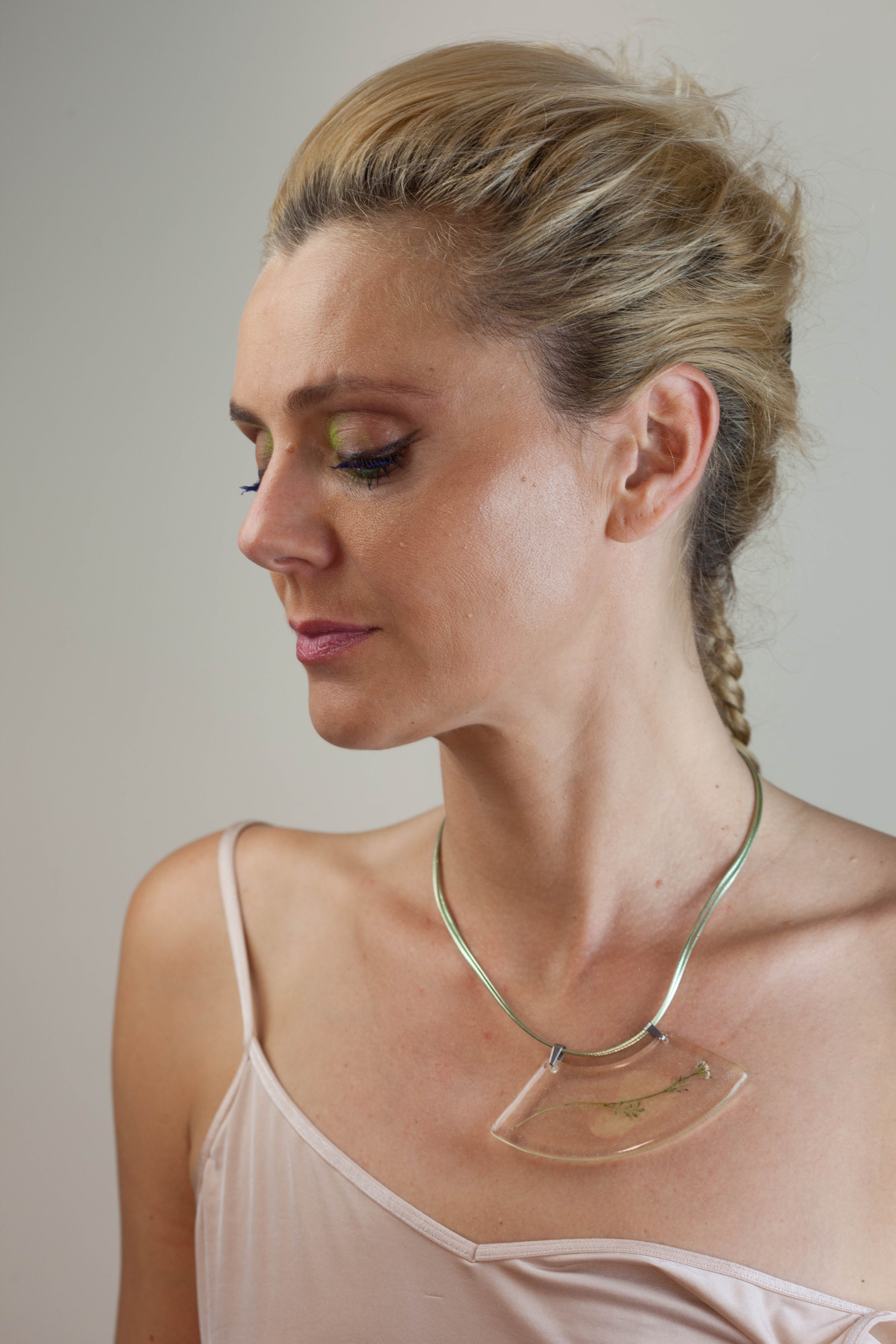 Woman in White Top and Gold-colored Necklace
