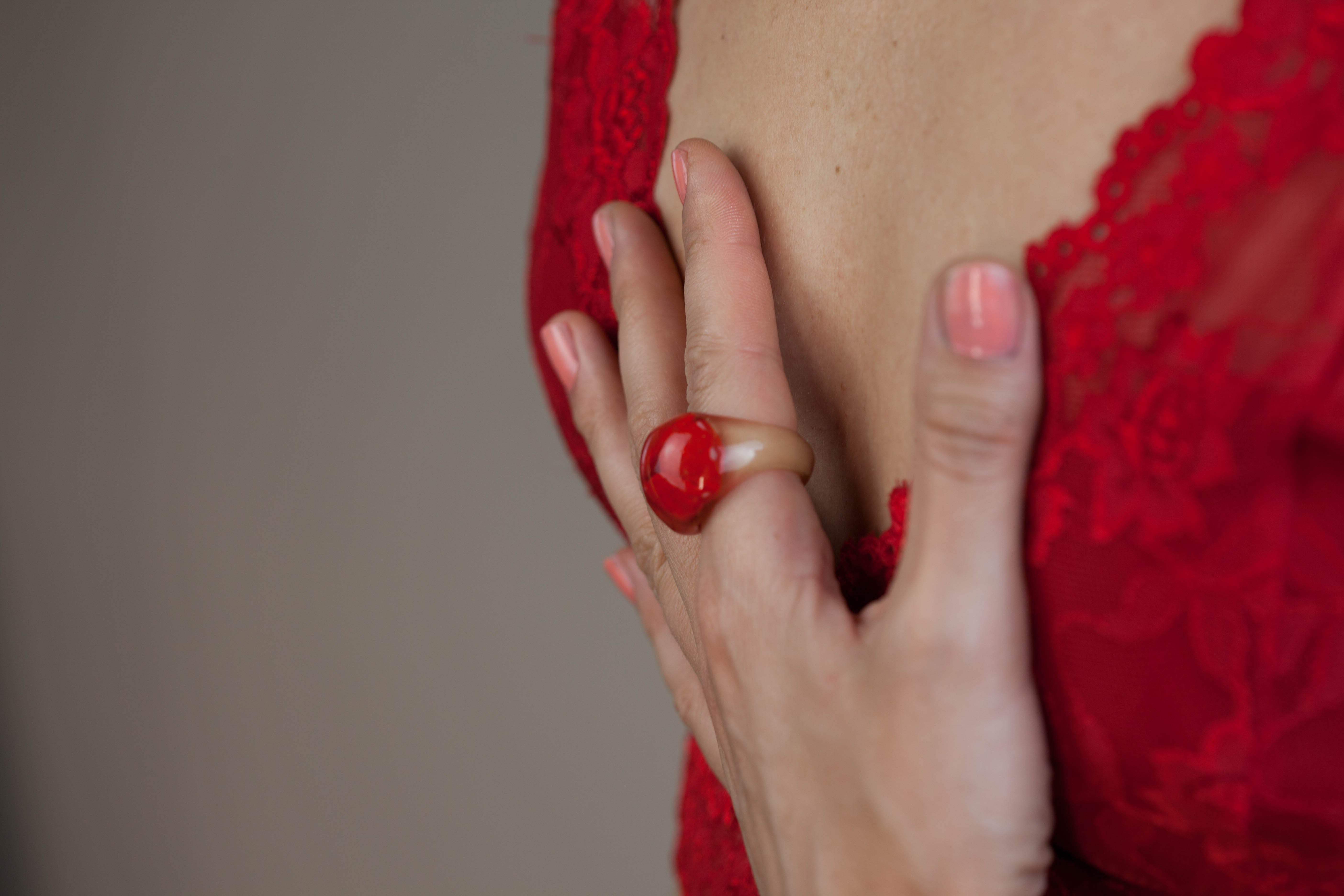 Woman in Pink Manicure Wearing Red and Brown Ring