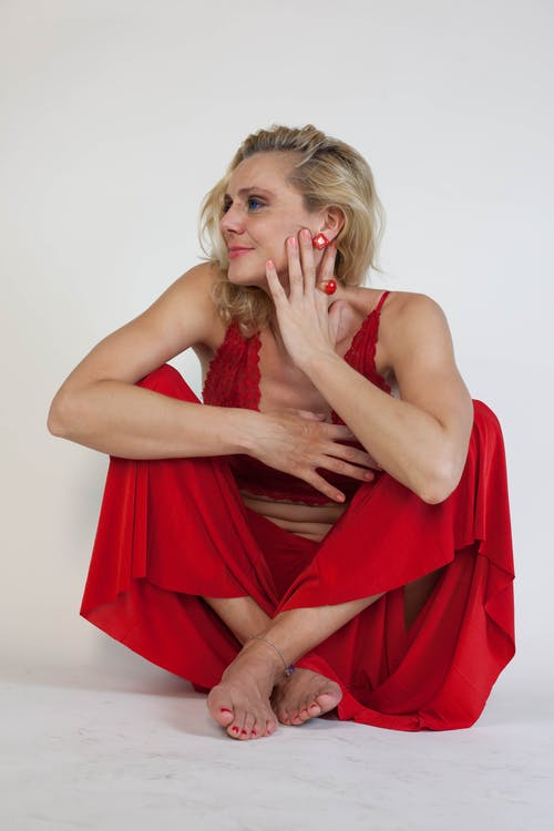 Woman Sitting Looking Sideways