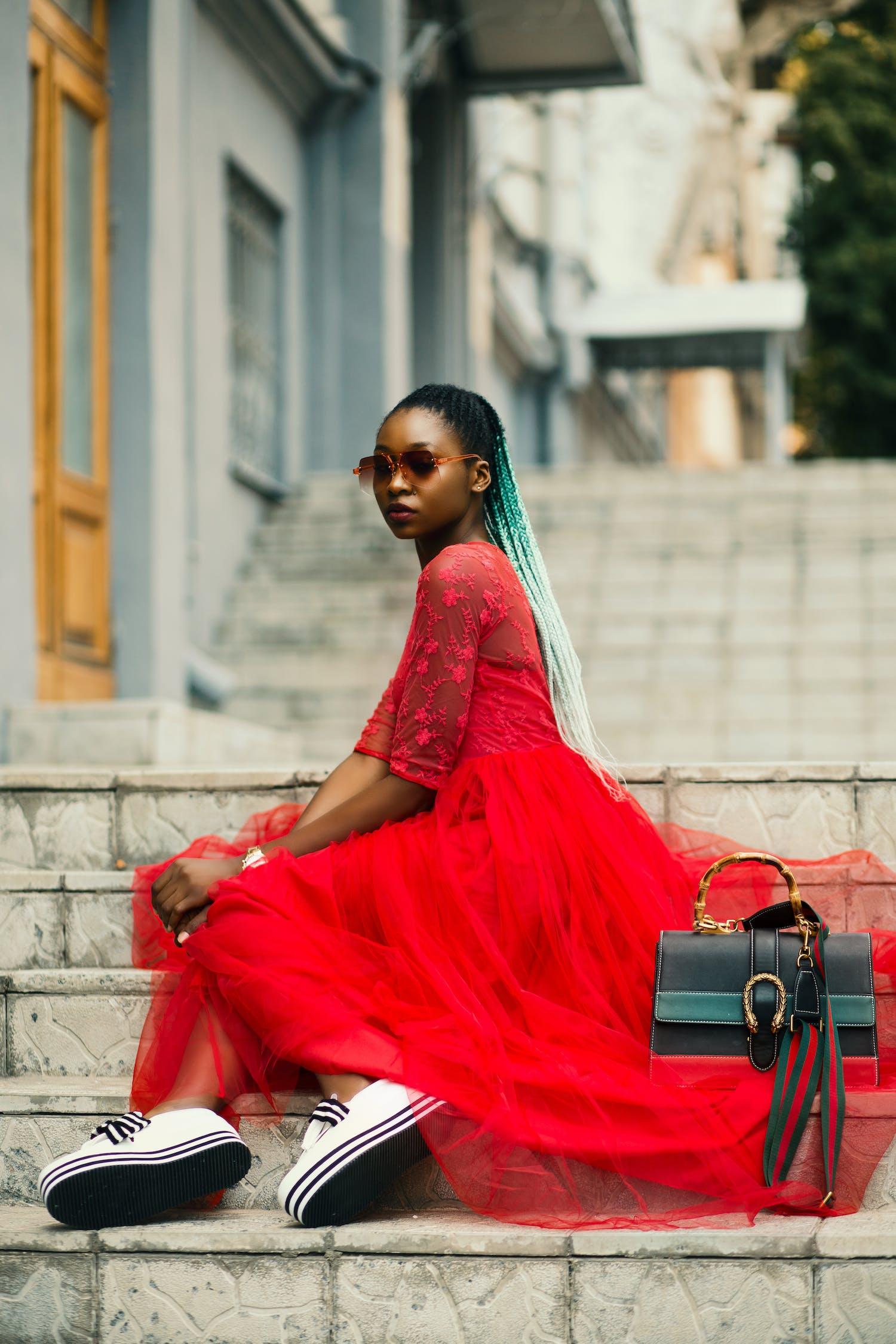 Woman Sitting on Stairway Wearing Sunglasses