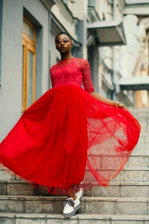 Woman Wear Red Elbow-sleeved Dress Walking on Stair