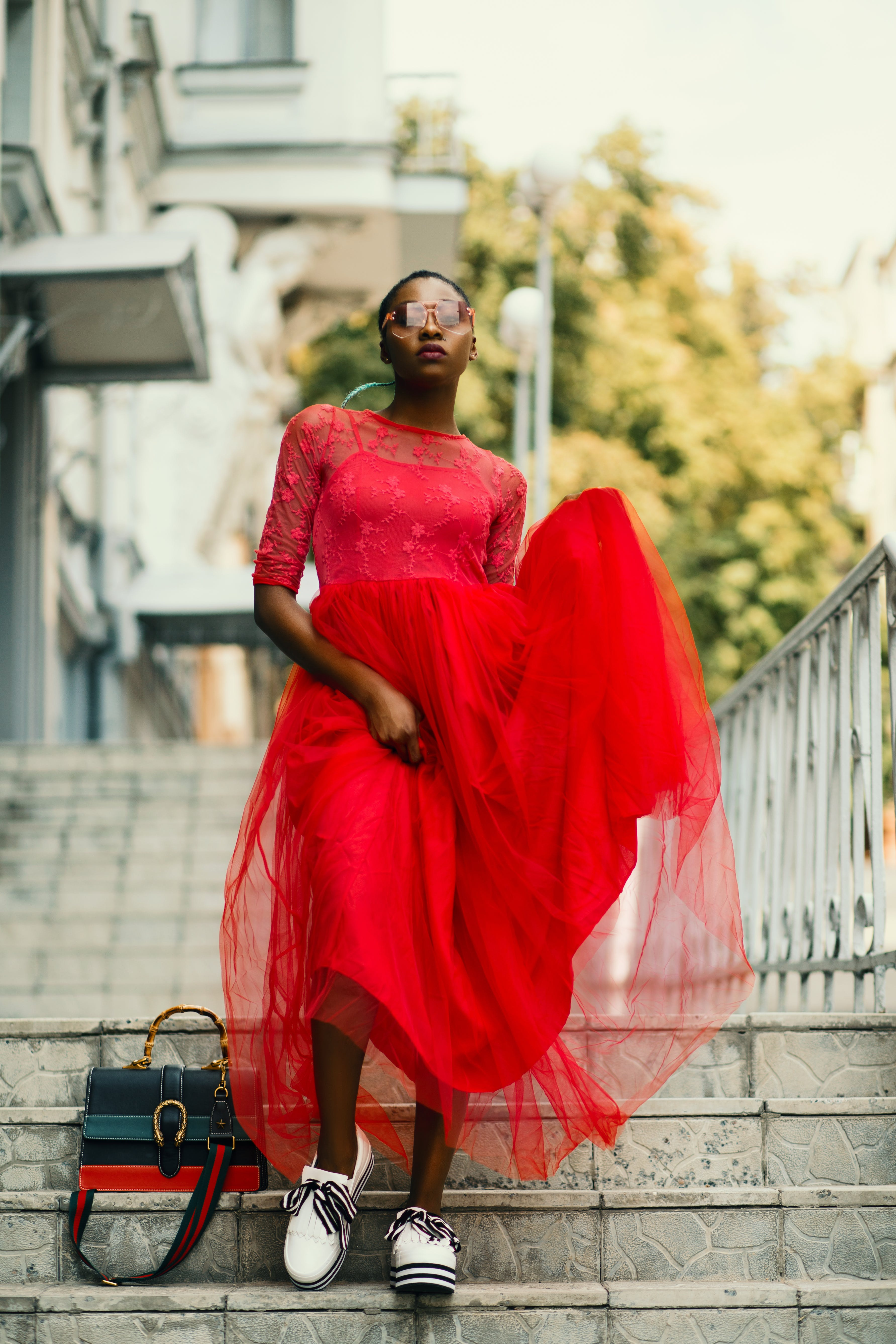 Woman Wearing Red Crew-neck Dress Walking on the Stairs Photography
