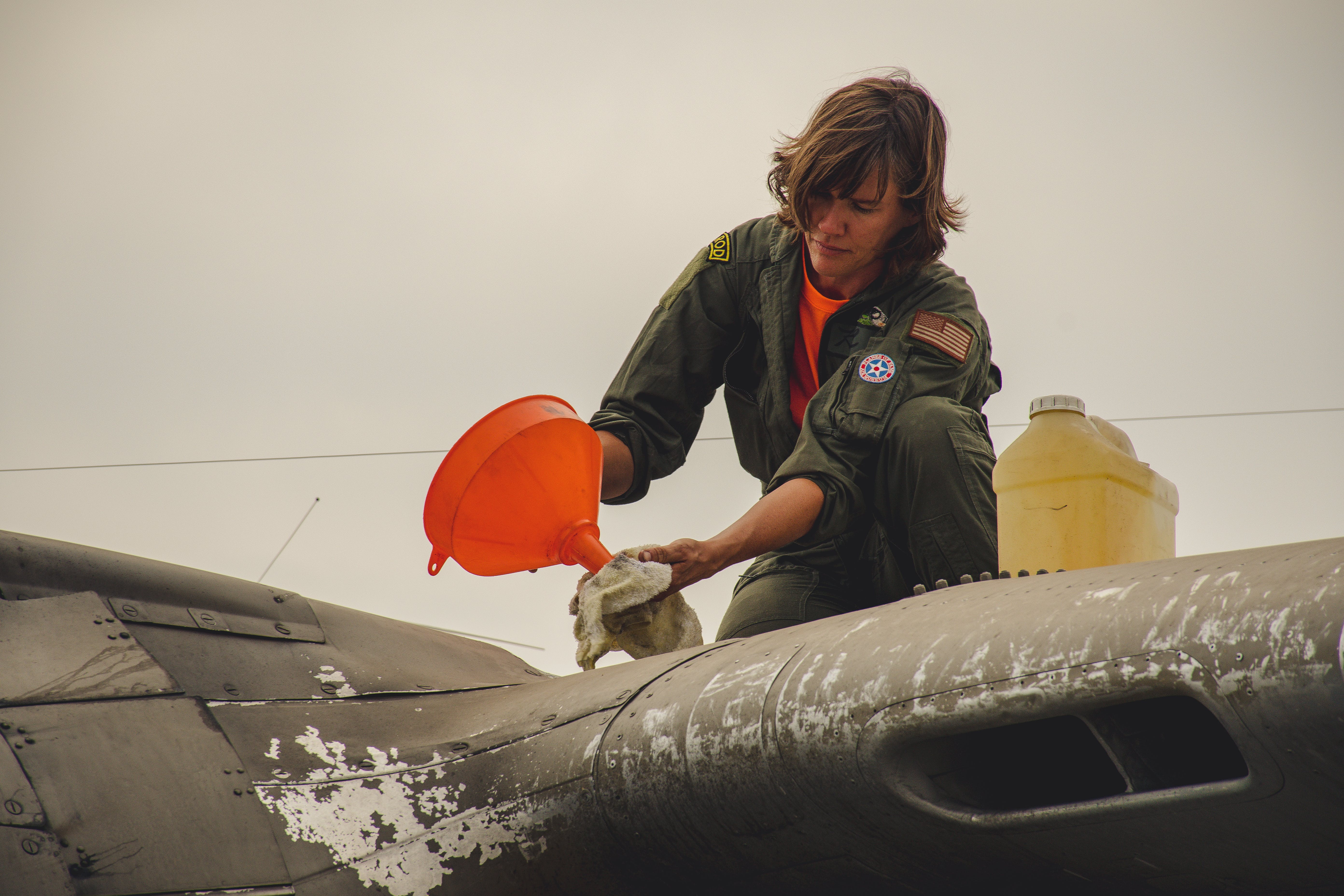 Person Cleaning Aircraft
