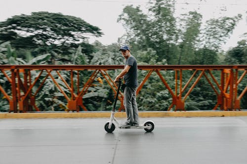 Man Riding on Bird Electric Scooter