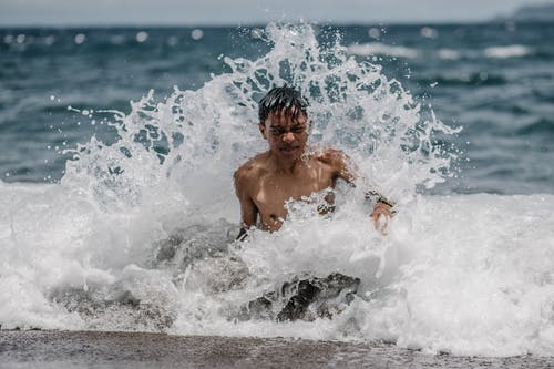 Boy Swimming on Sea