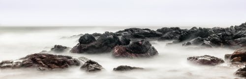 Black Rock With Fog