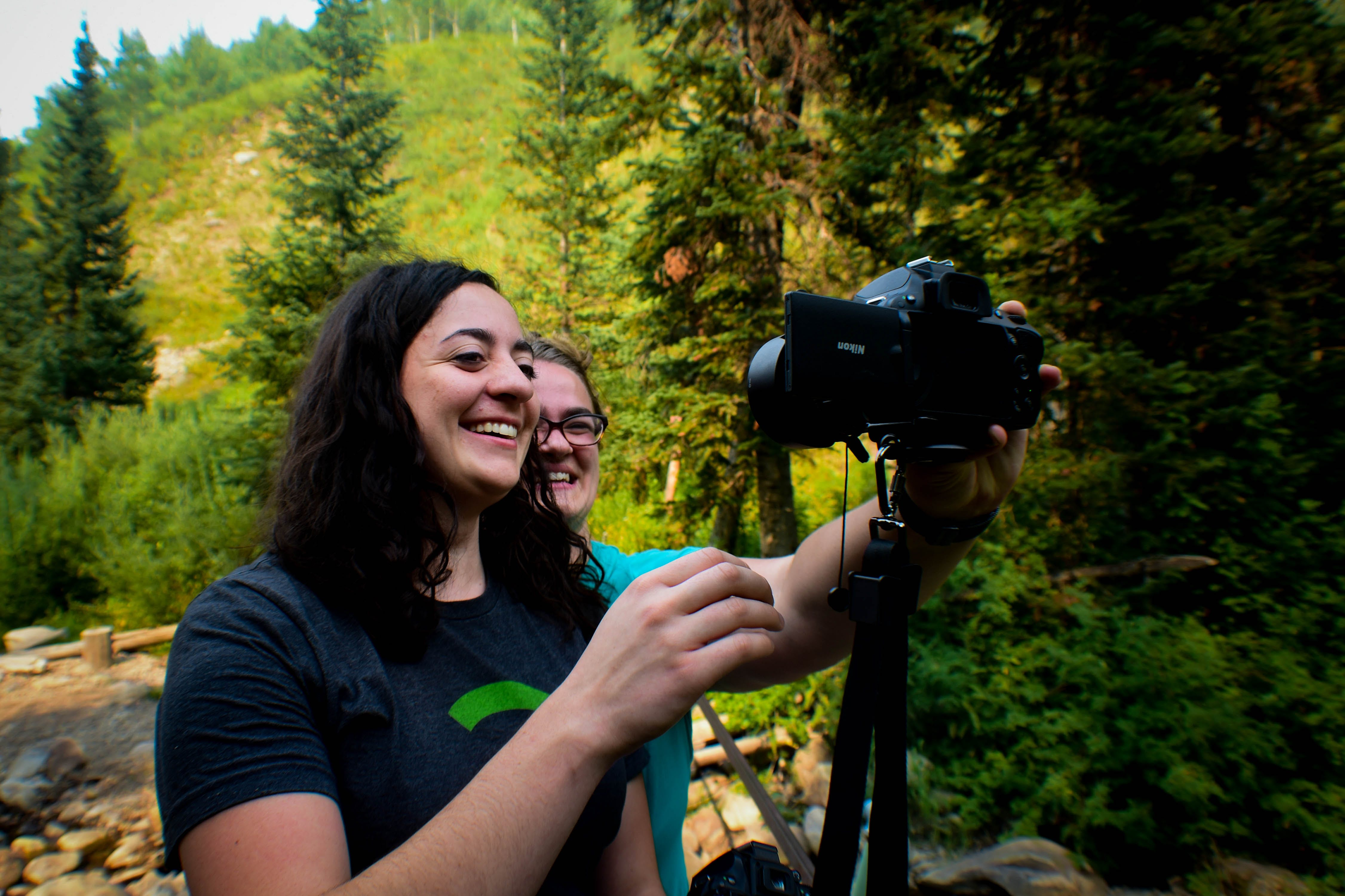 Two Woman Taking Selfie in Middle of Forest