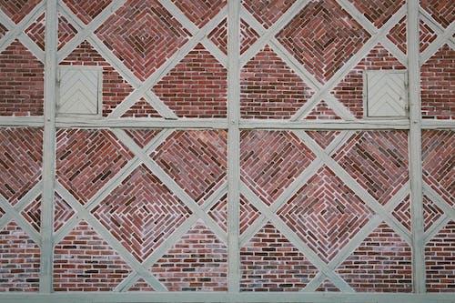 Gratis stockfoto met architectuur, baksteen, baksteen structuur, bakstenen muur
