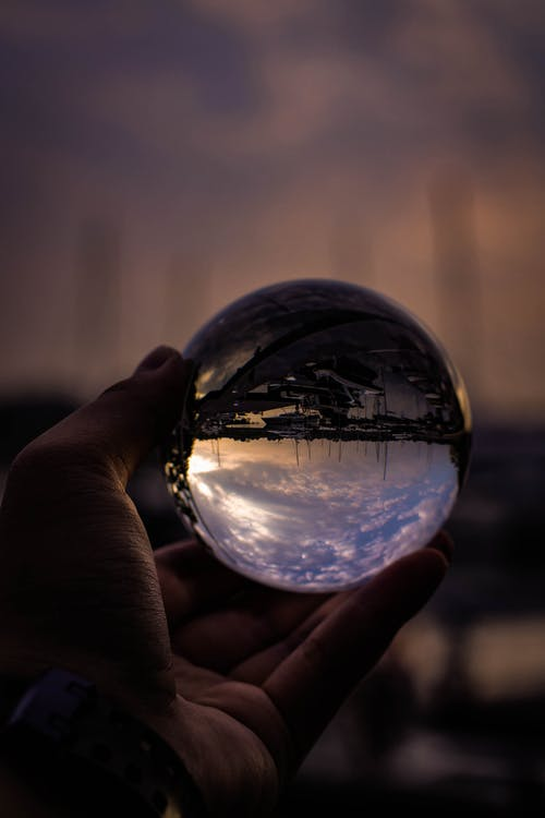 Person Holding Glass Ball