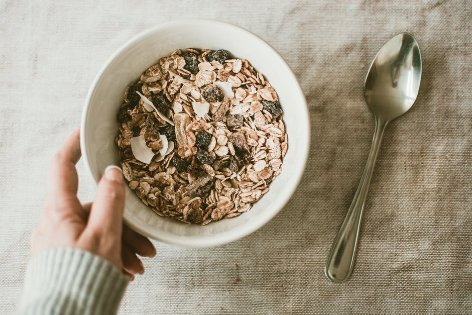 Person Holding Bowl Full of Oats