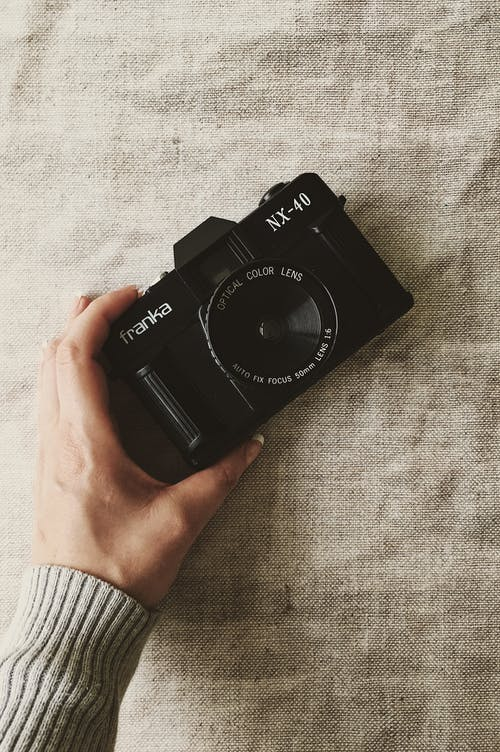 Person Holding Black Franka Nx-40 Slr Camera