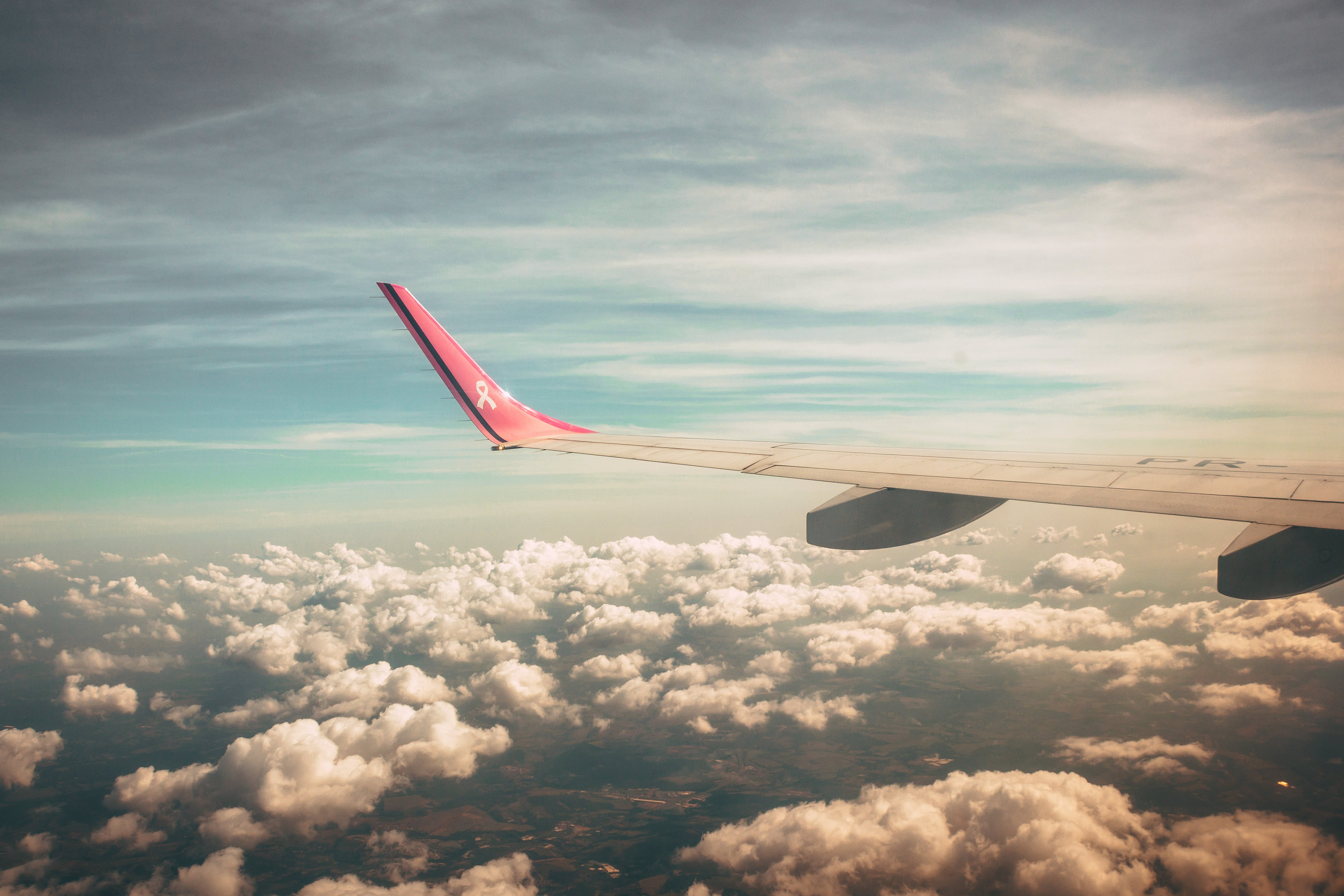 Aerial Photography of Airplane Wing over Clouds
