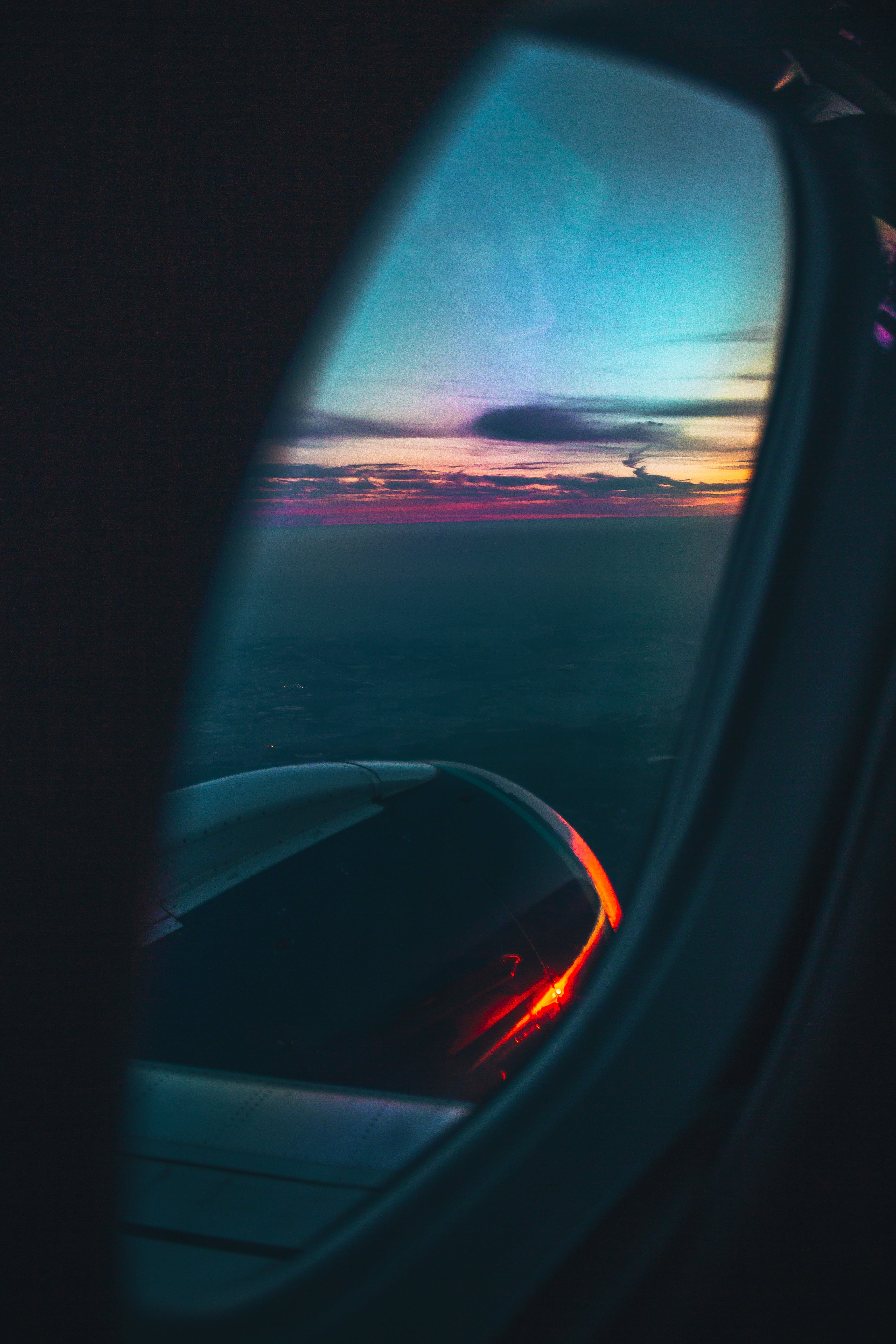 Shallow Focus Photography Of Airplane Window