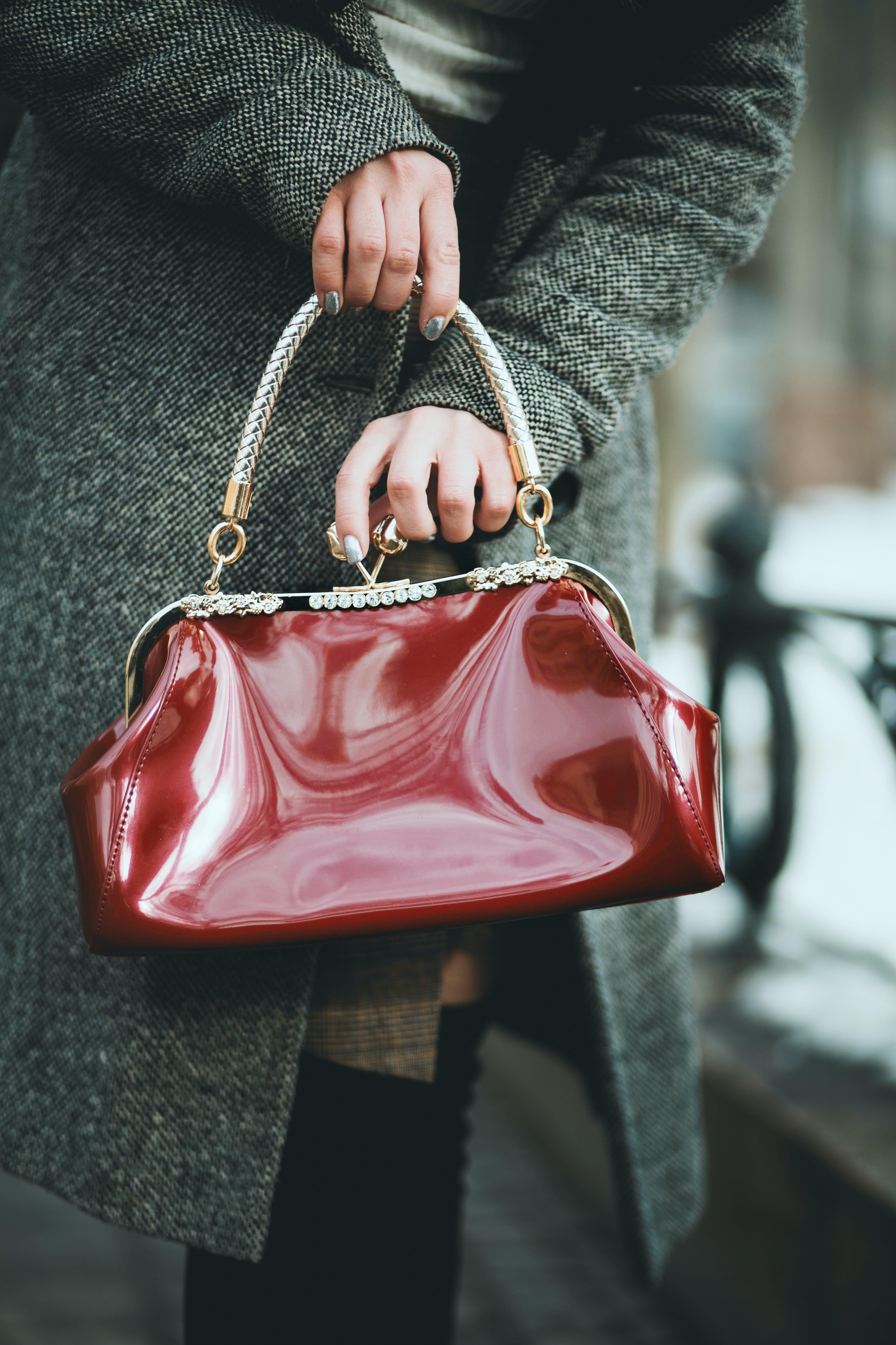 Woman Holding Red Handbag