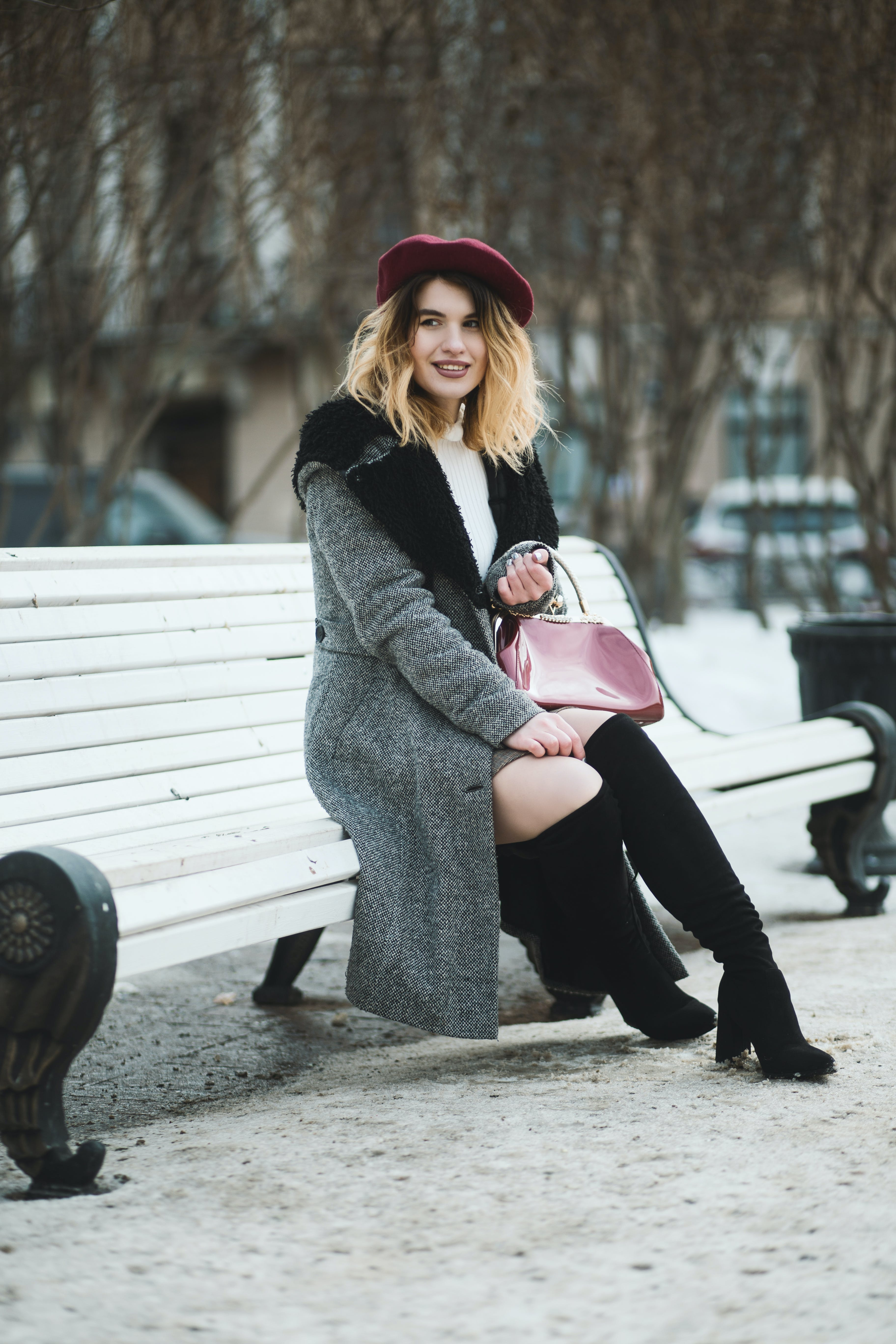Smiling Woman Sitting On Bench