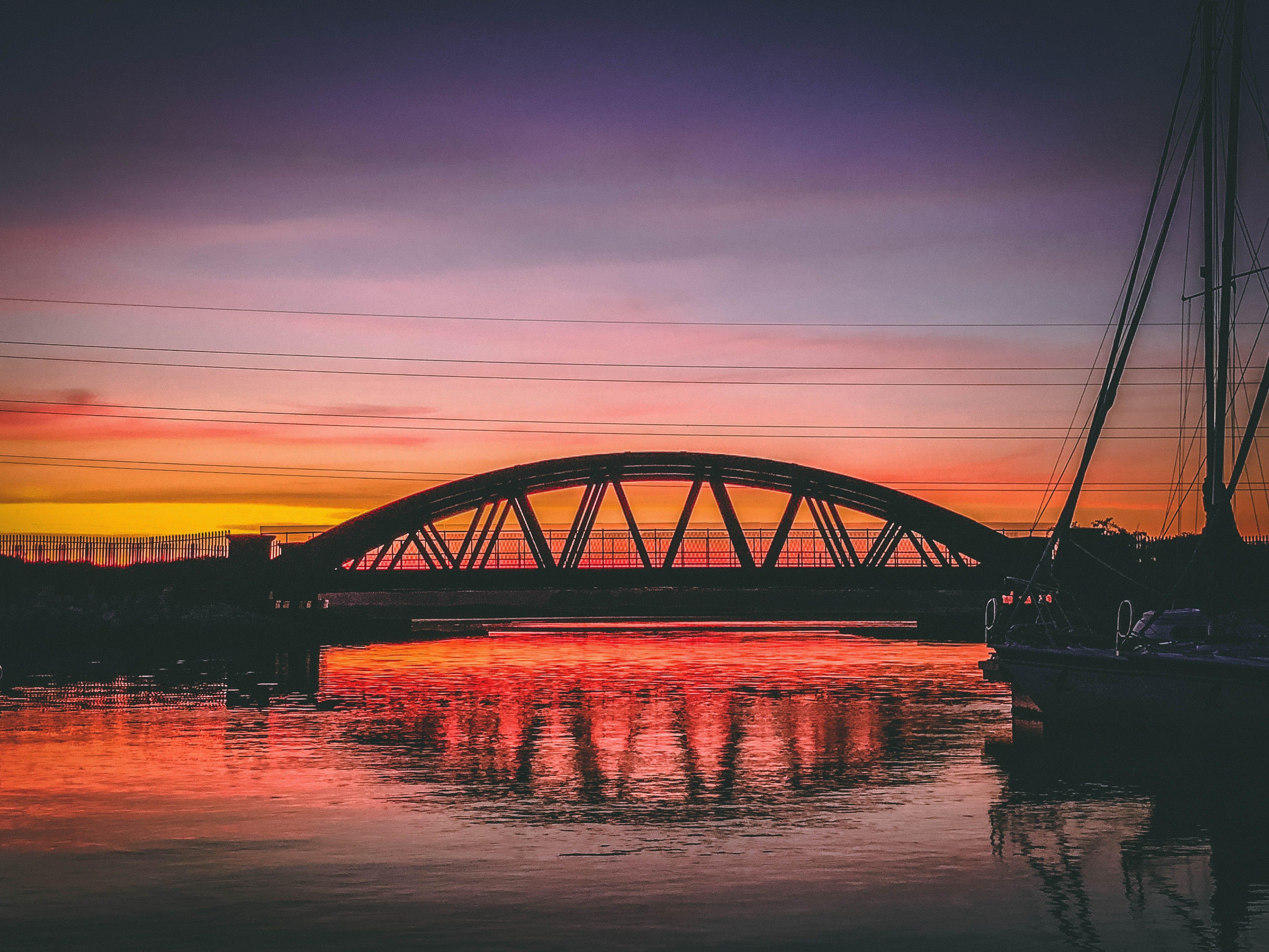 Silhouette Of Bridge Under Orange Sky