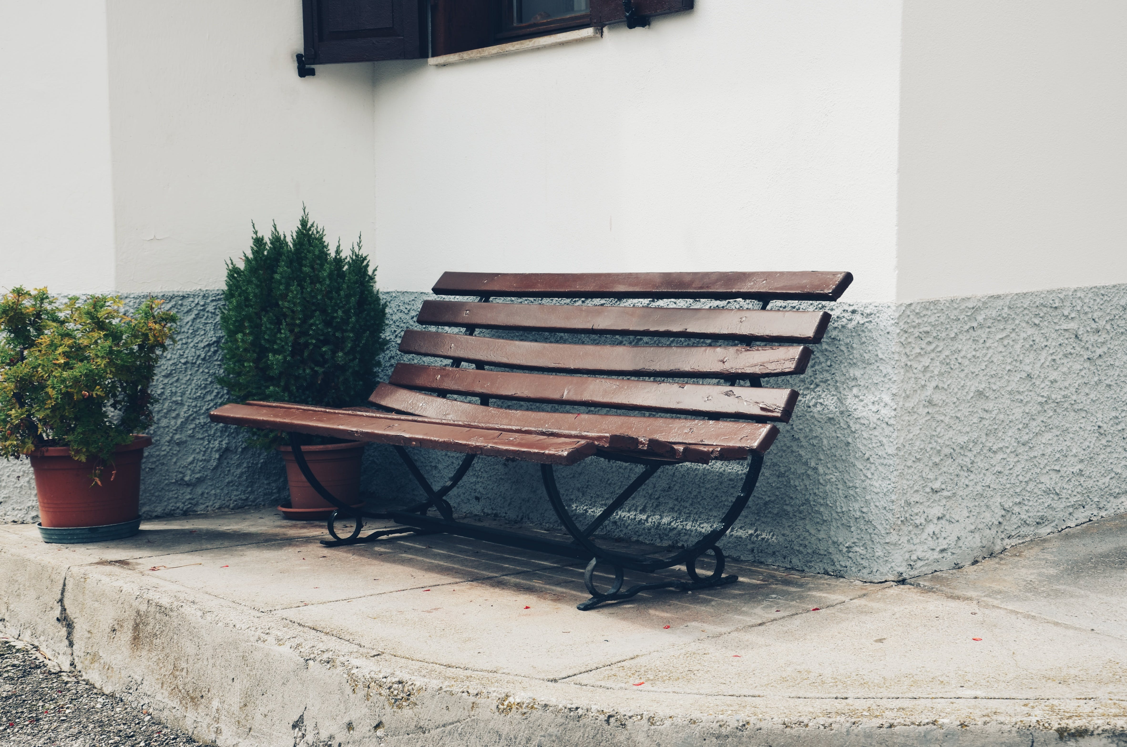 Brown Bench Near Wall