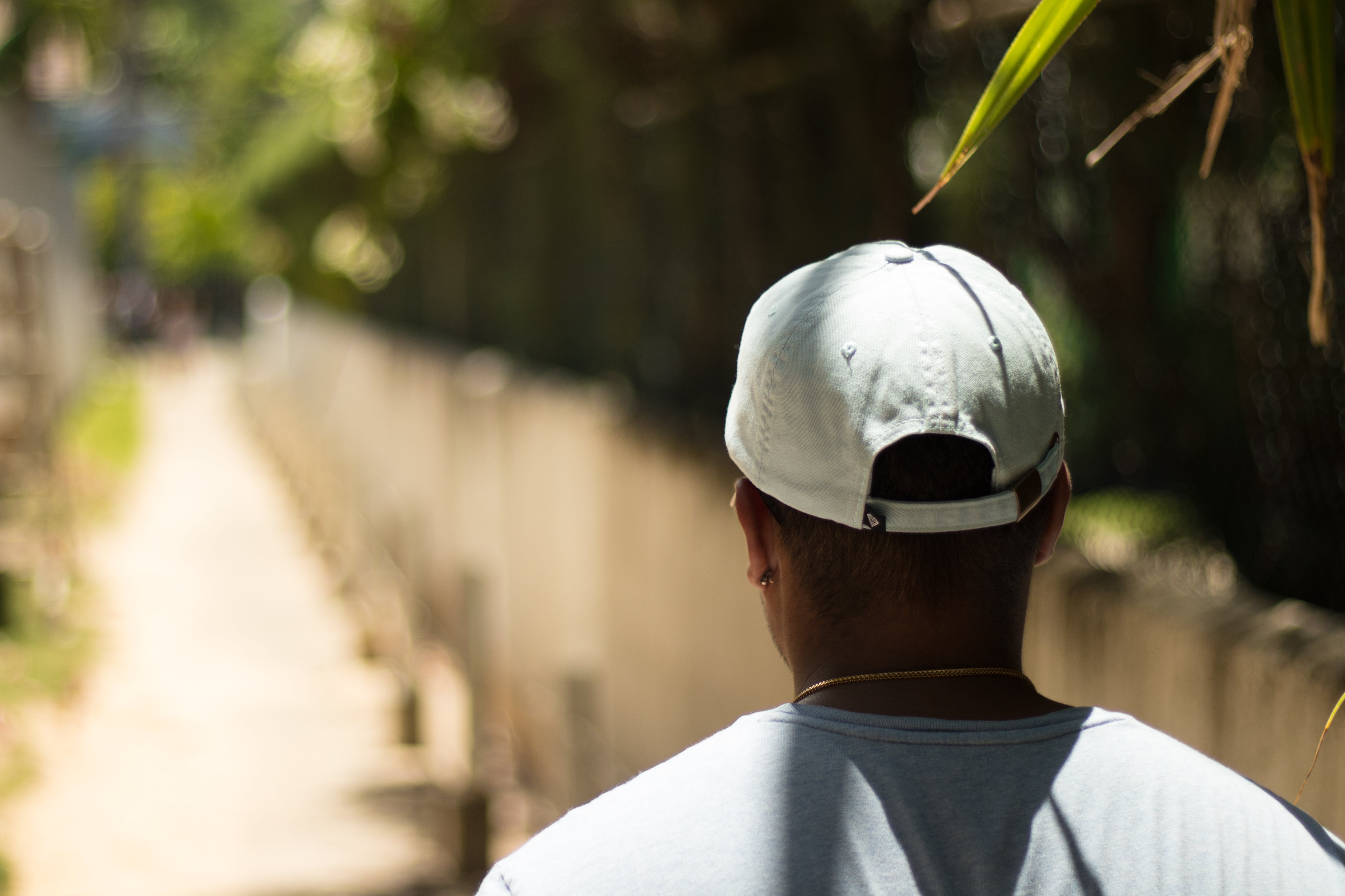 Selective Focus Photography Of Man Wearing A Hat