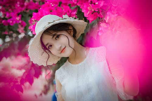 Woman Surrounded By Pink Bougainvillea Flowers