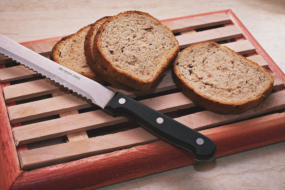 Slices Of Bread Beside Knife