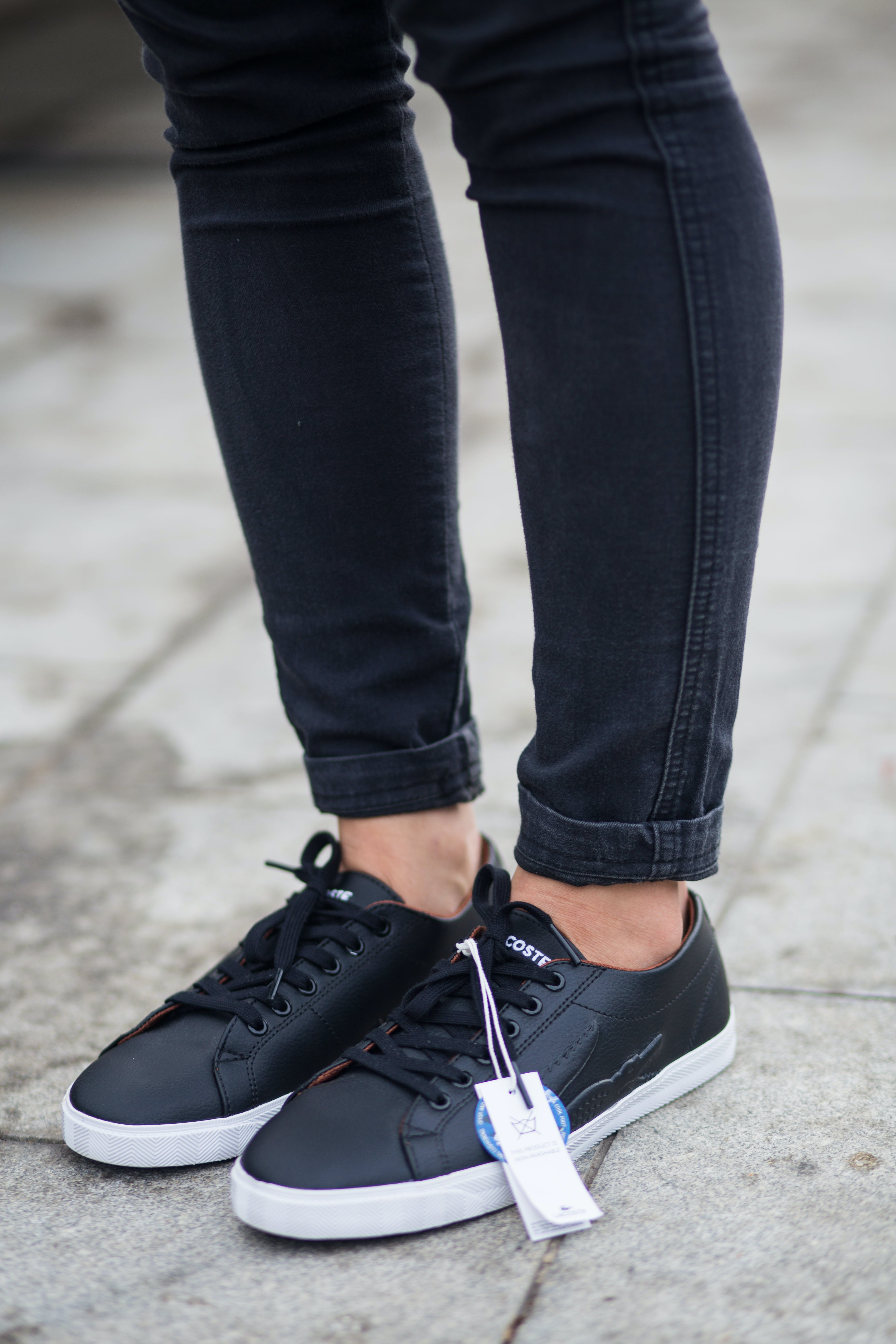 Person Wearing Black Pants And Pair Of Black Sneakers