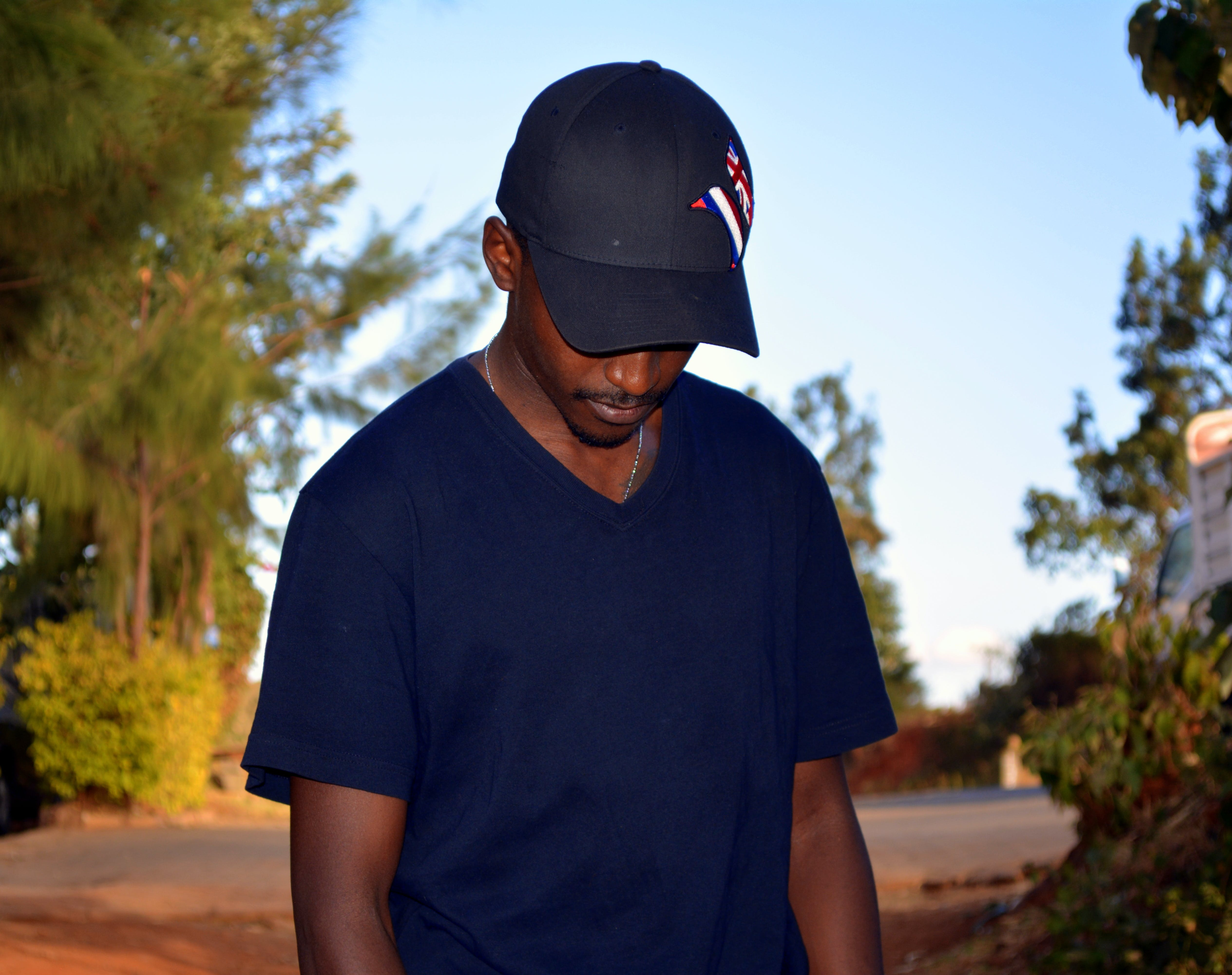 Man Wearing Black Fitted Cap And Black V-neck T-shirt