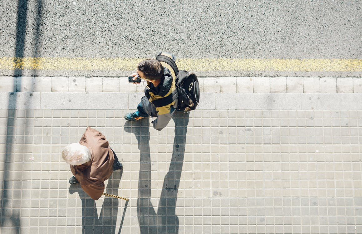 High-angle Photography of Two Person Walking Beside Road