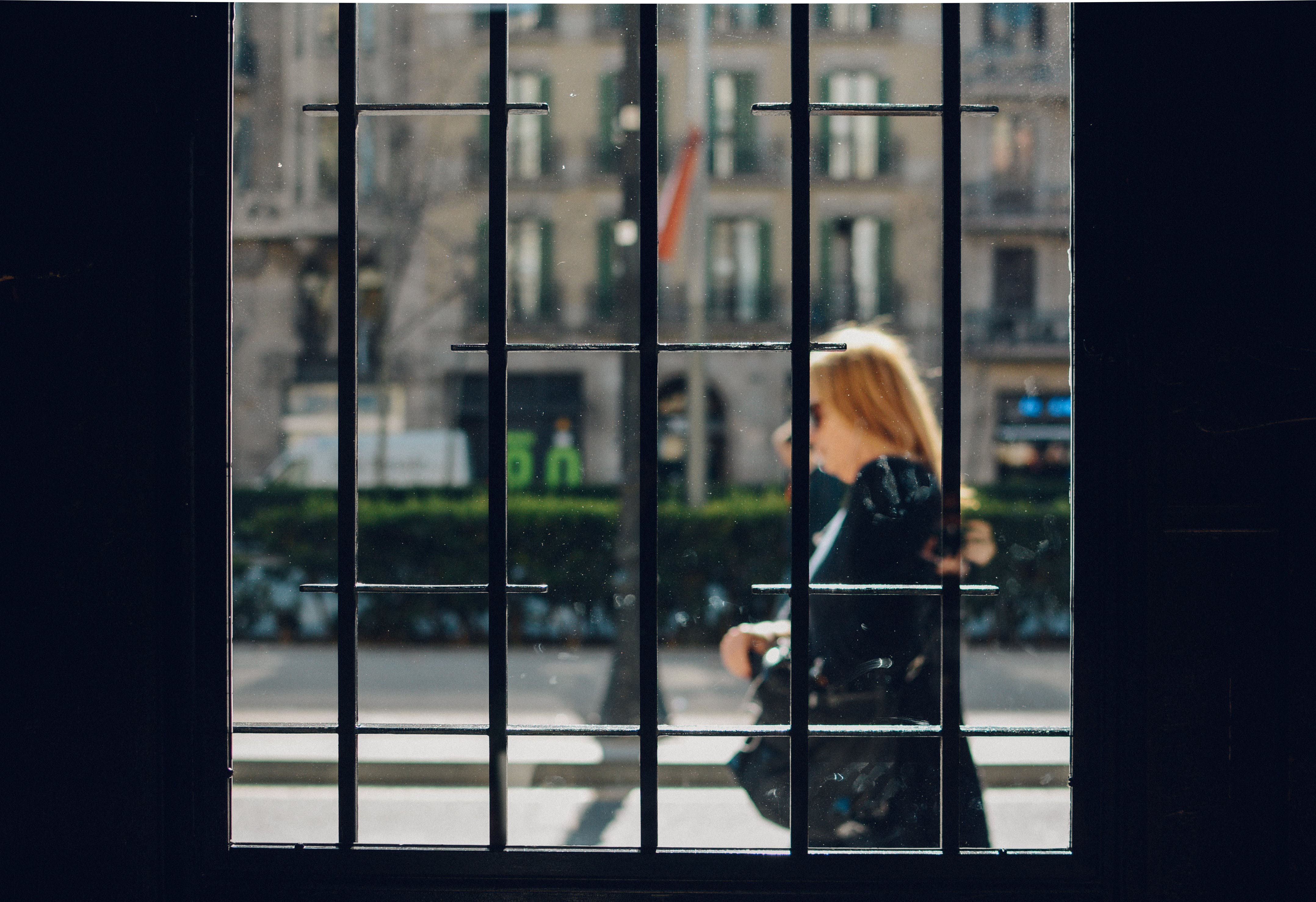 Woman Walking in Front of Building
