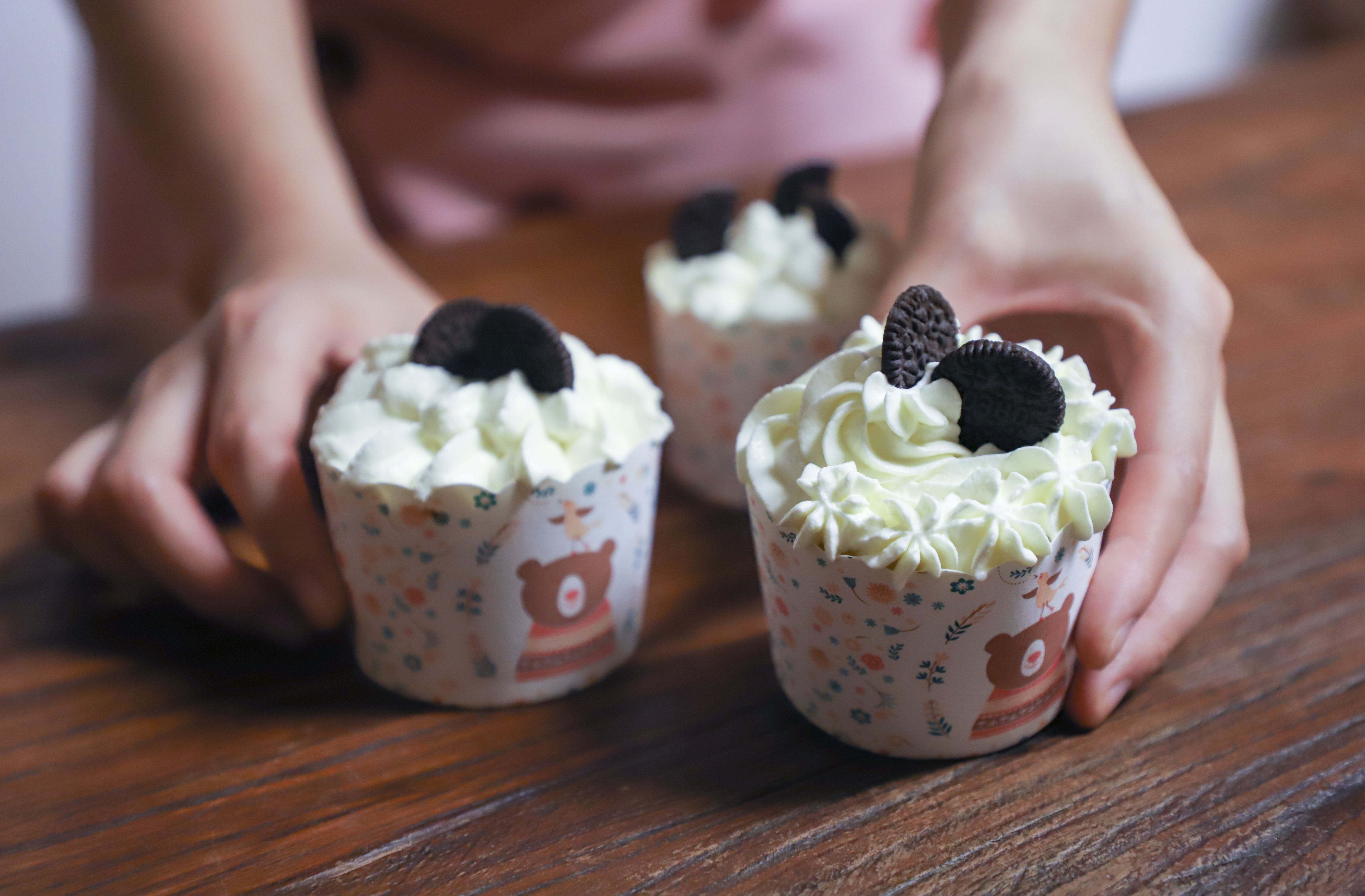 Person Holding Cupcakes