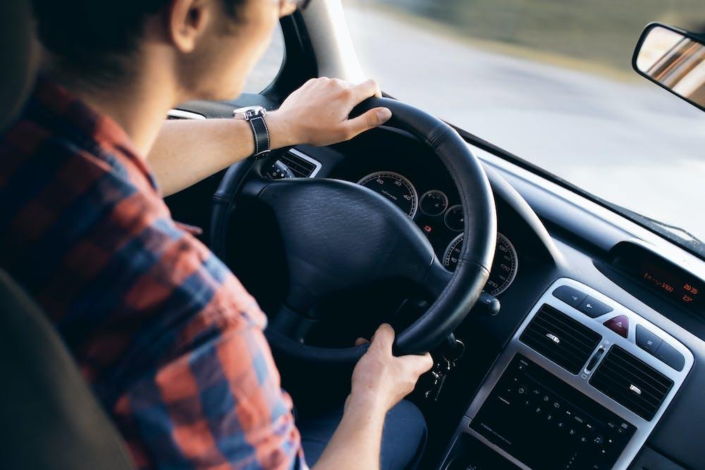 Man inside the car | Photo: Pexels