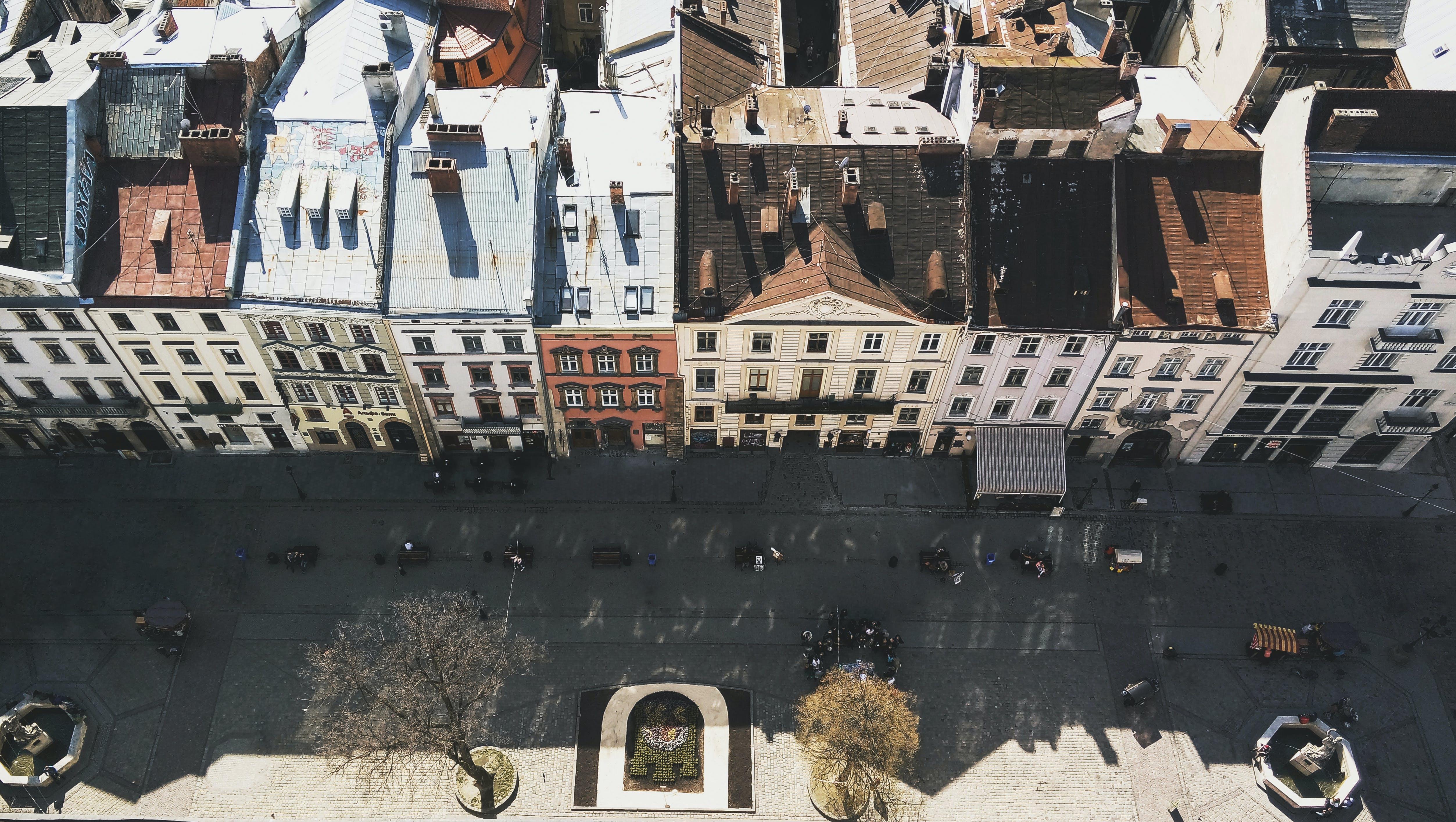 Aerial Shot Of Vehicles on Road Beside Buildings