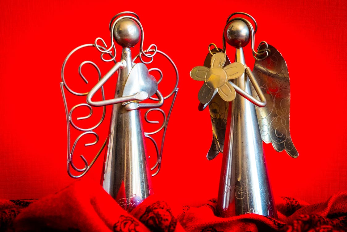 Two Silver Angel Figurines