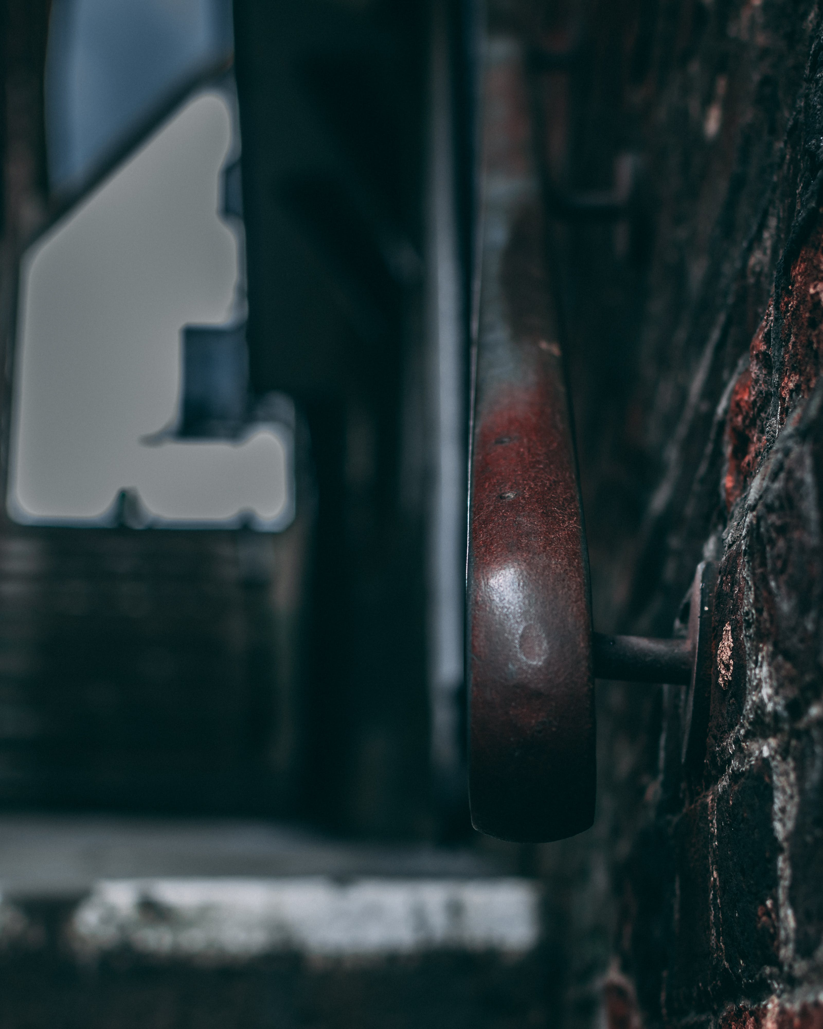 Selective Close-up Photography of Metal Rail