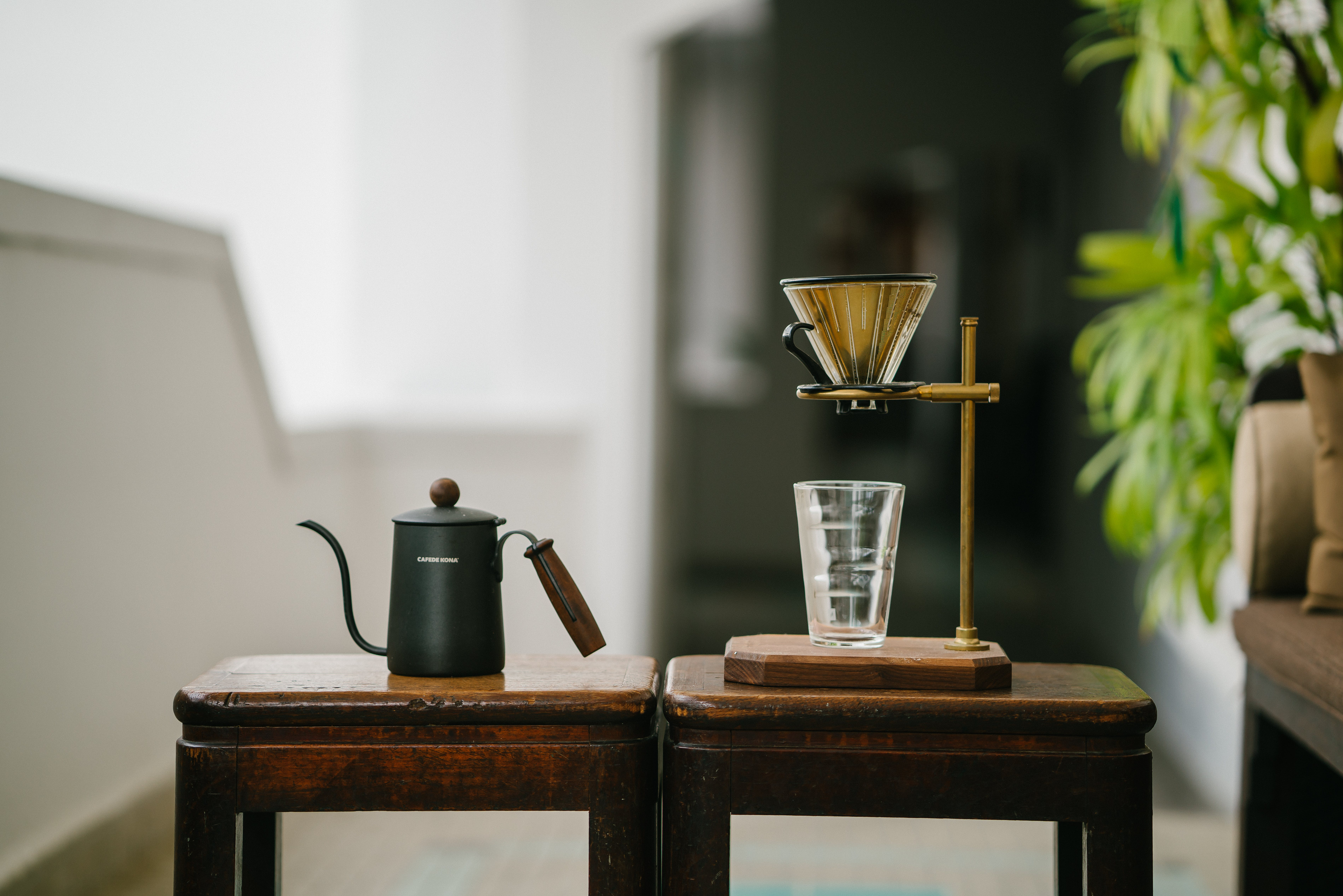 Teapot Beside Drinking Glass on Tables