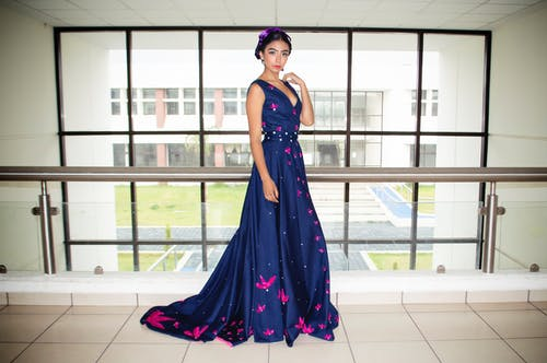 Woman Wearing Blue Floor Length Gown