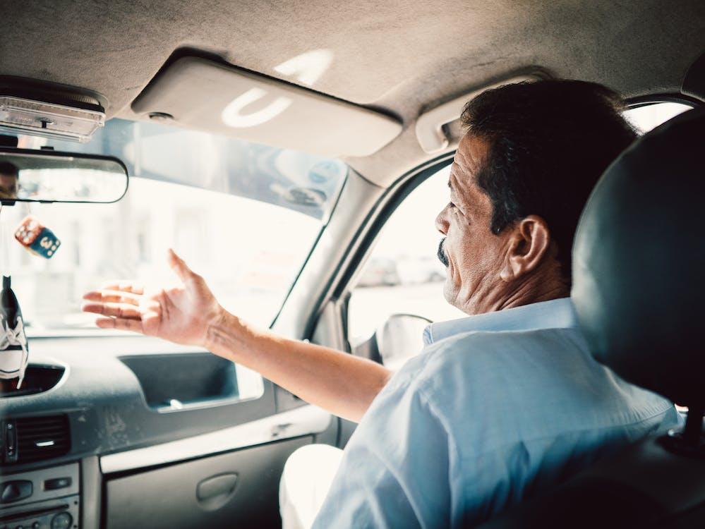 Man Sitting on Passenger Seat