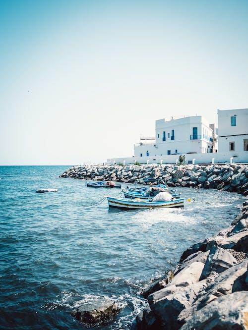 Boats Near Rocks