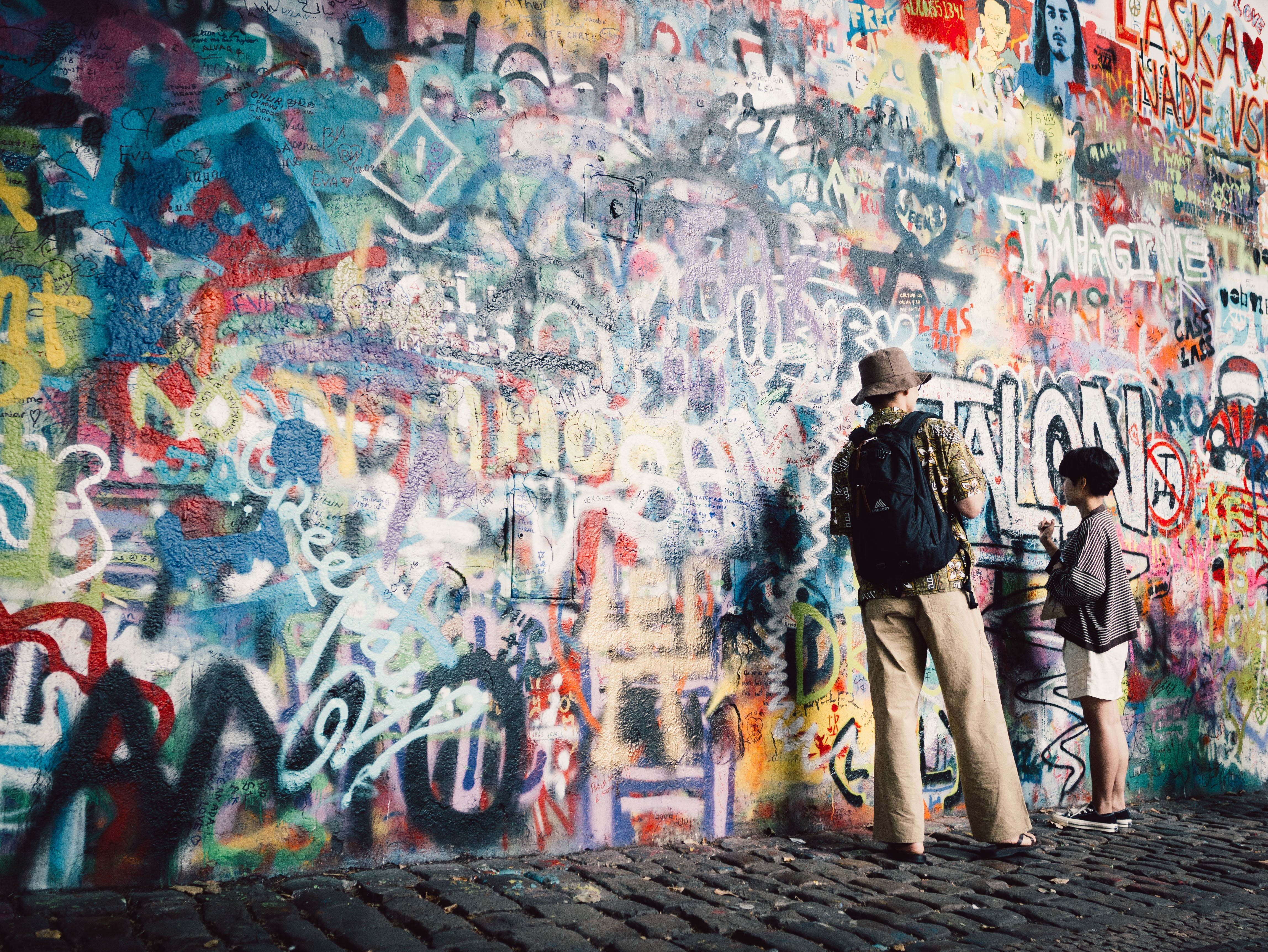 Man and Boy Painting the Wall